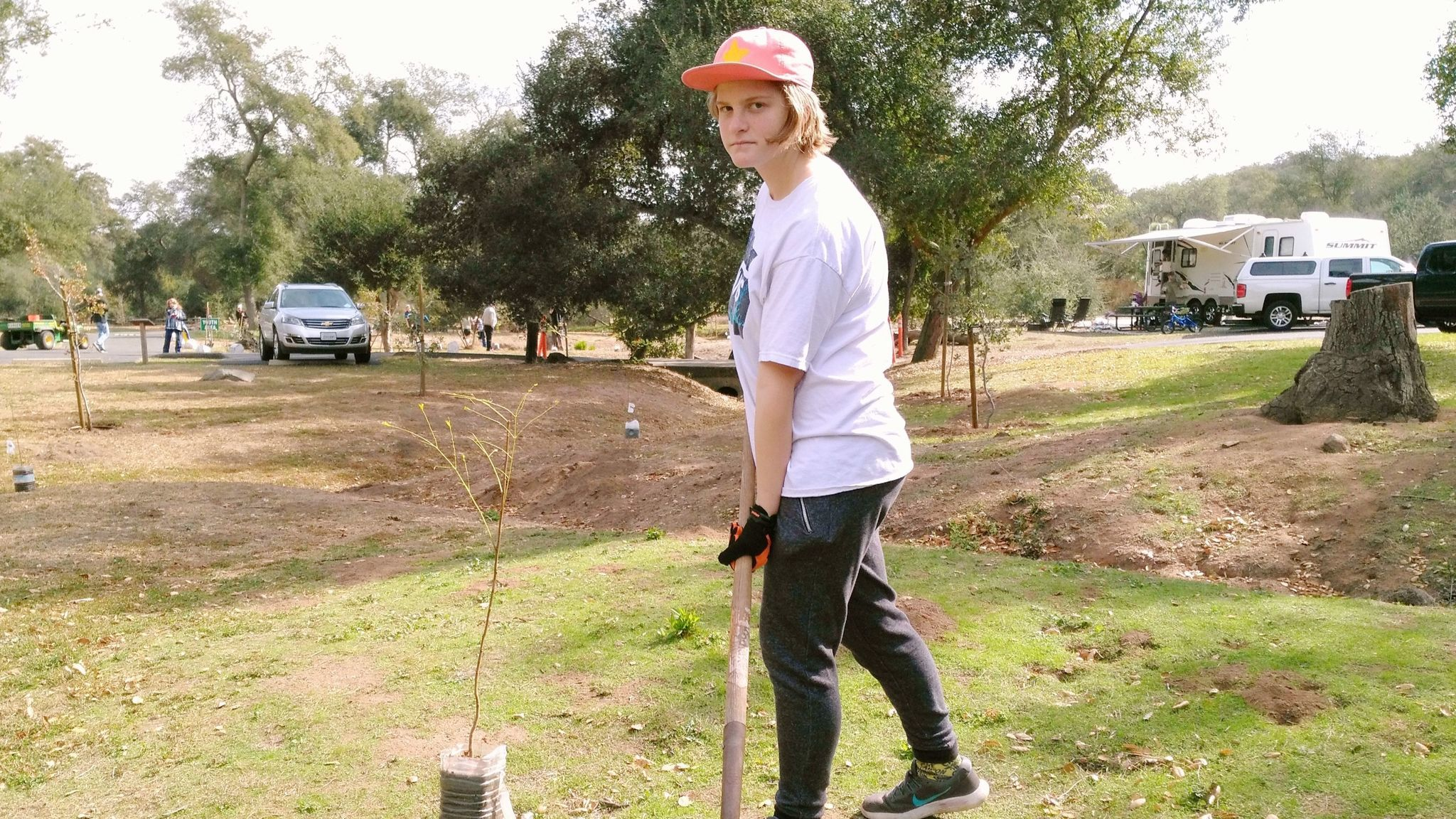 Ramona High School freshman Meghan Dollard, 14, shovels dirt for a new tree to help replenish those at Dos Picos County Park harmed by drought and a goldspotted oak borer beetle.