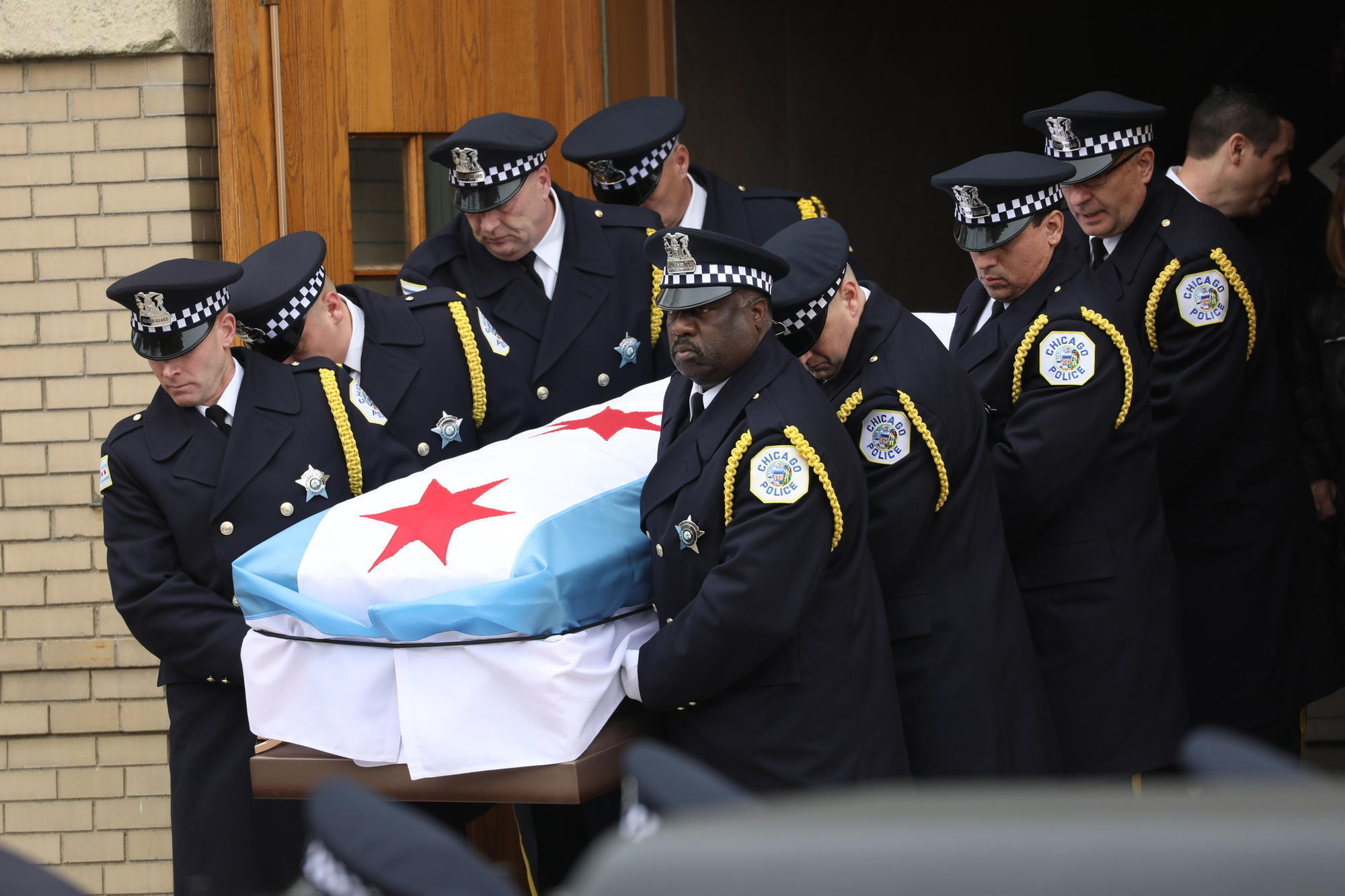slain police commander laid to rest with stories of selflessness