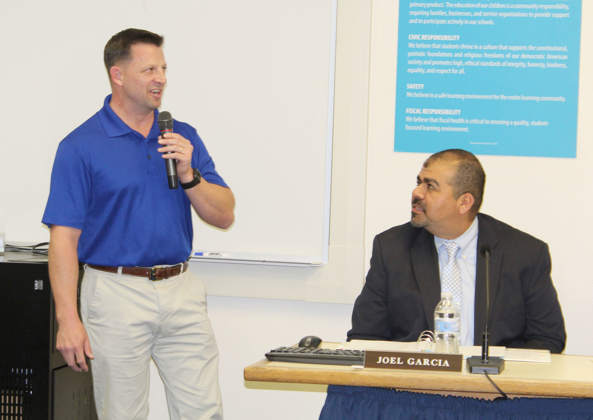 Retired U.S. Coast Guard Lt. Cmdr. and Ramona High Senior Naval Science Instructor Adam Birst talks about the school's NJROTC program. Also pictured is Asst. Supt. Joel Garcia.