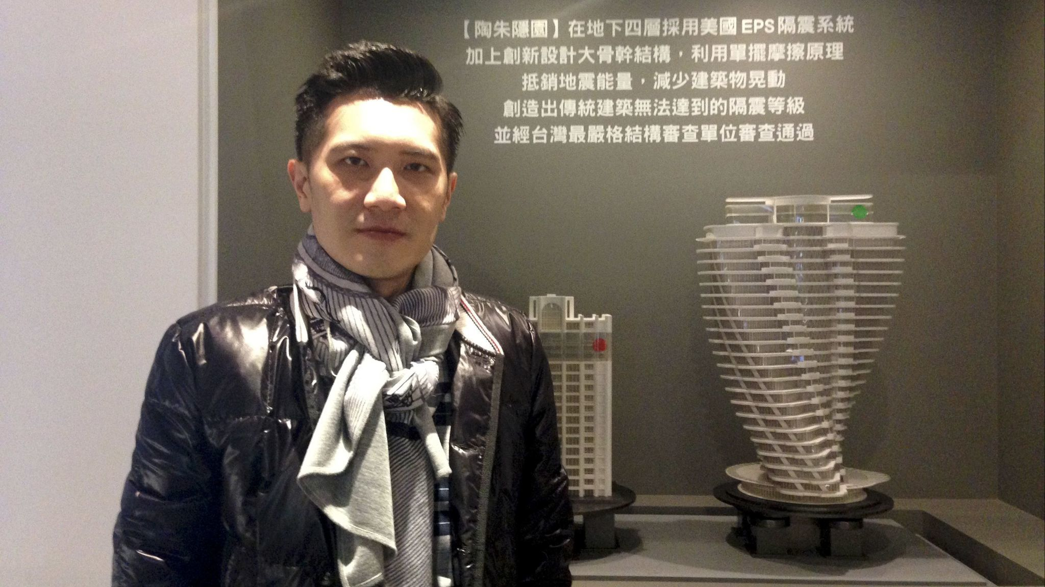 Eliot Shen, project manager of the Tao Zhu Yi Yuan tower in Taipei, stands with a model of his build