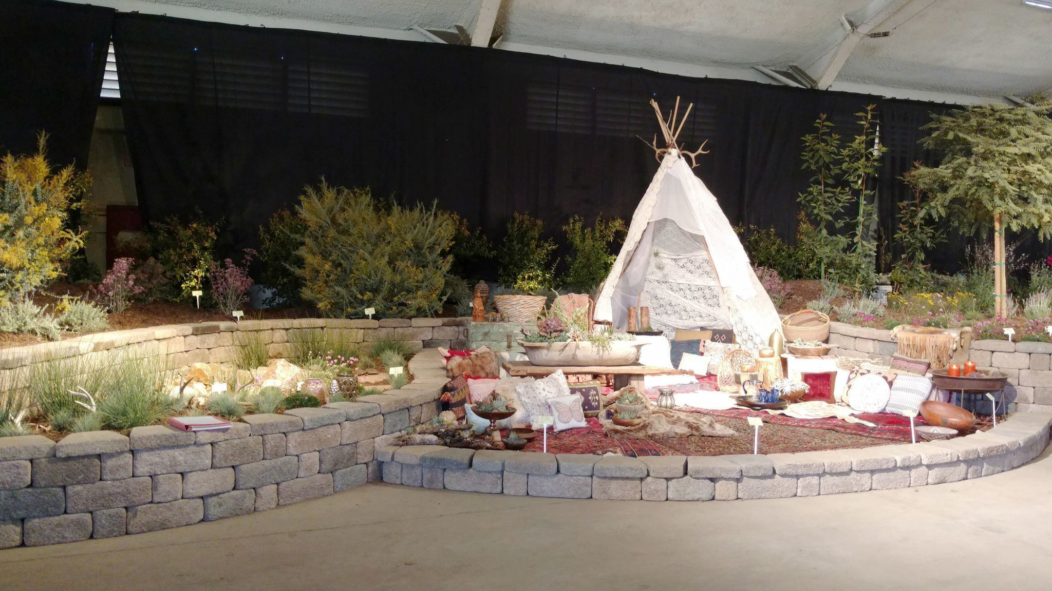 """A tipi is one of the featured design elements in Scotty's Plantscapes' """"Bohemian Living"""" entry in the Garden Masters Exhibition at the Del Mar Fairgrounds."""