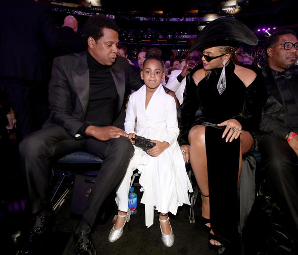 Jay-Z, left, Blue Ivy and Beyoncé attend the 60th Grammy Awards. (Christopher Polk / Getty Images)