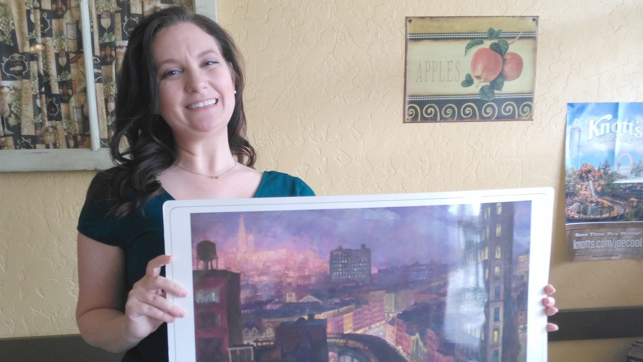 """Sarah Willat displays a print of John Sloan's """"The City from Greenwich Village,"""" which is being used to teach art to elementary school students in Ramona."""