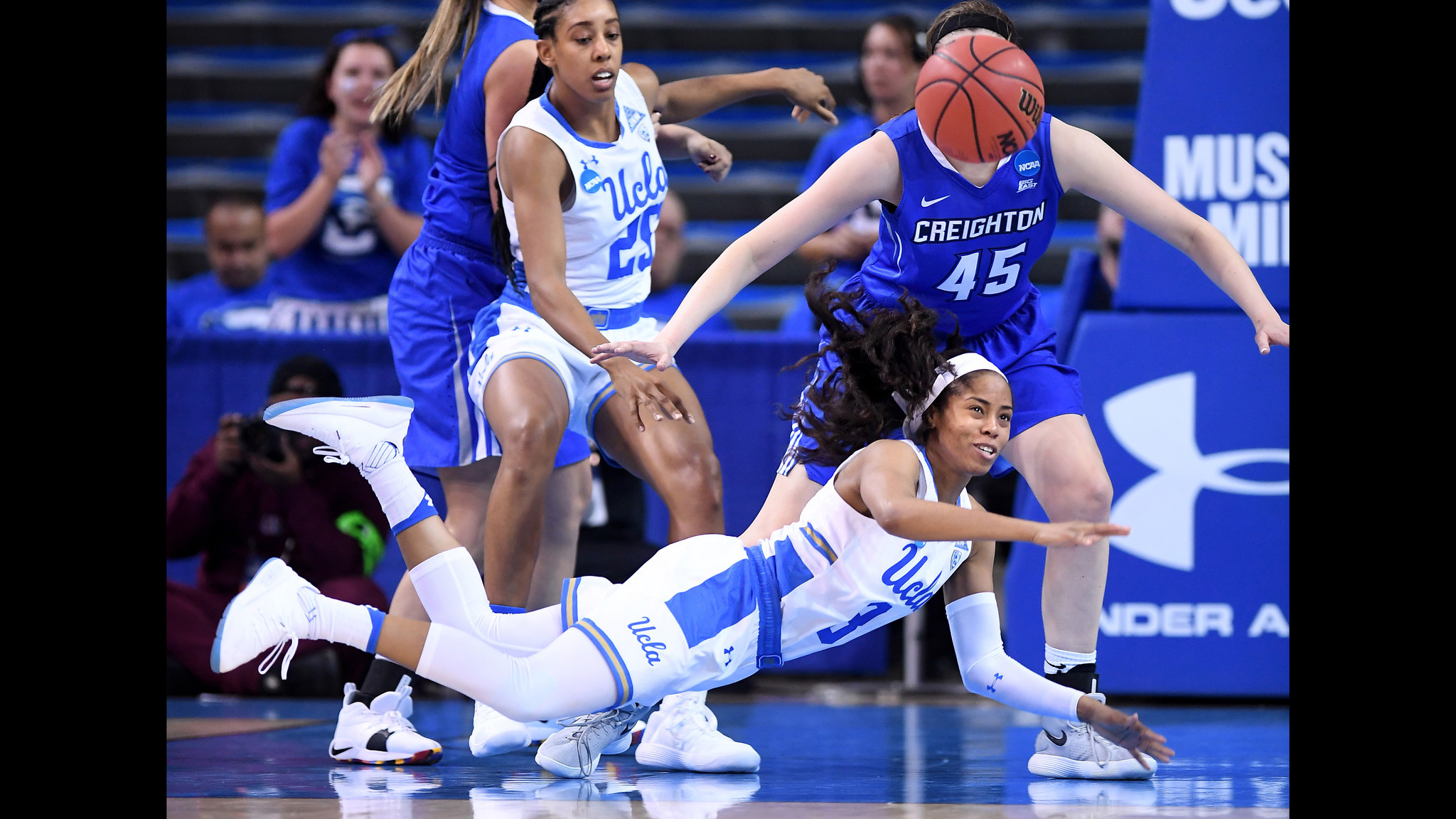 LOS ANGELES, CALIFORNIA MARCH 19, 2018-UCLA's Jordin Canada gets a pass off despite tripping against