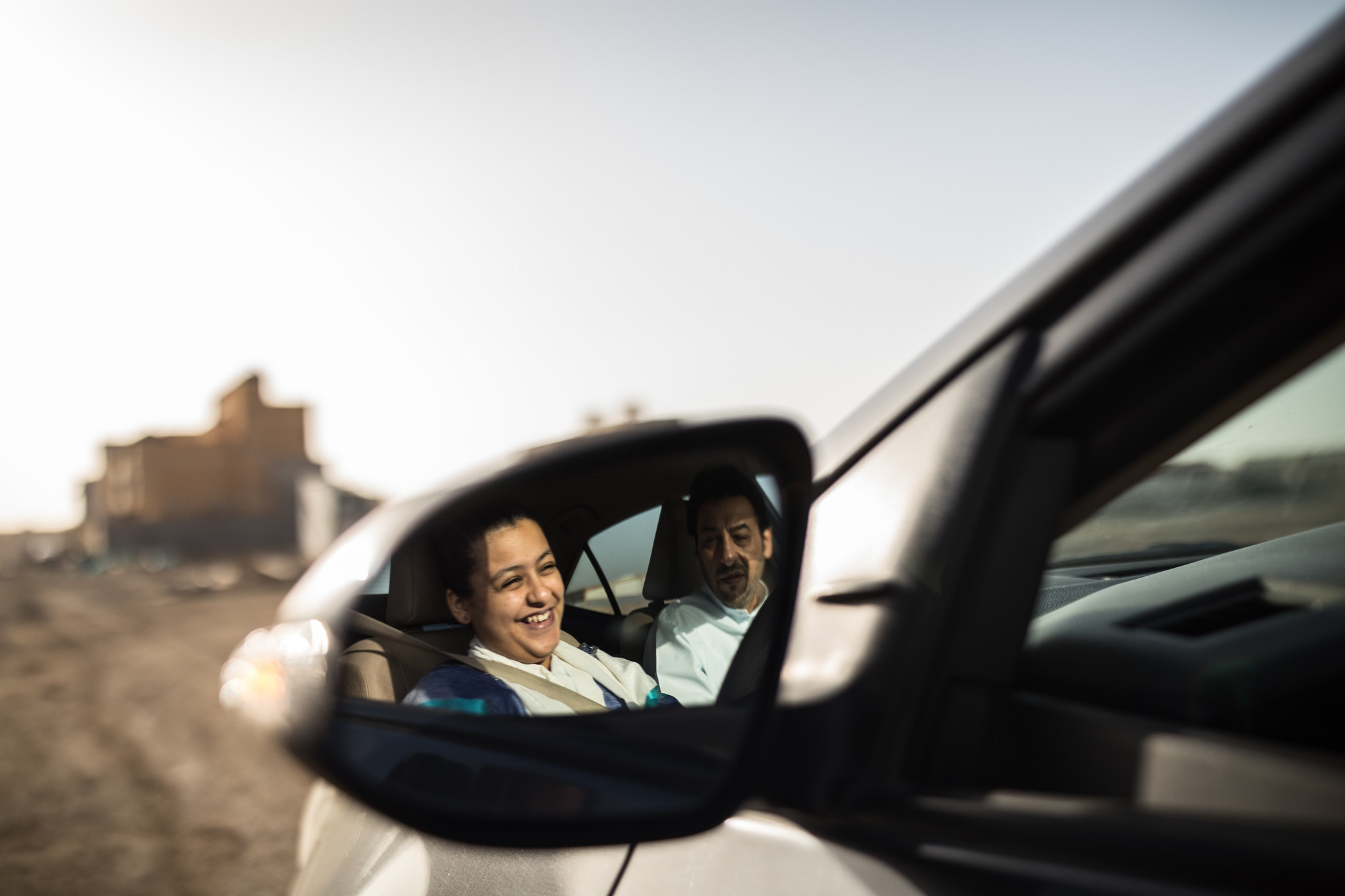 Tala Murad, a Saudi Arabian university student, receives a driving lesson from her father, Midhat.