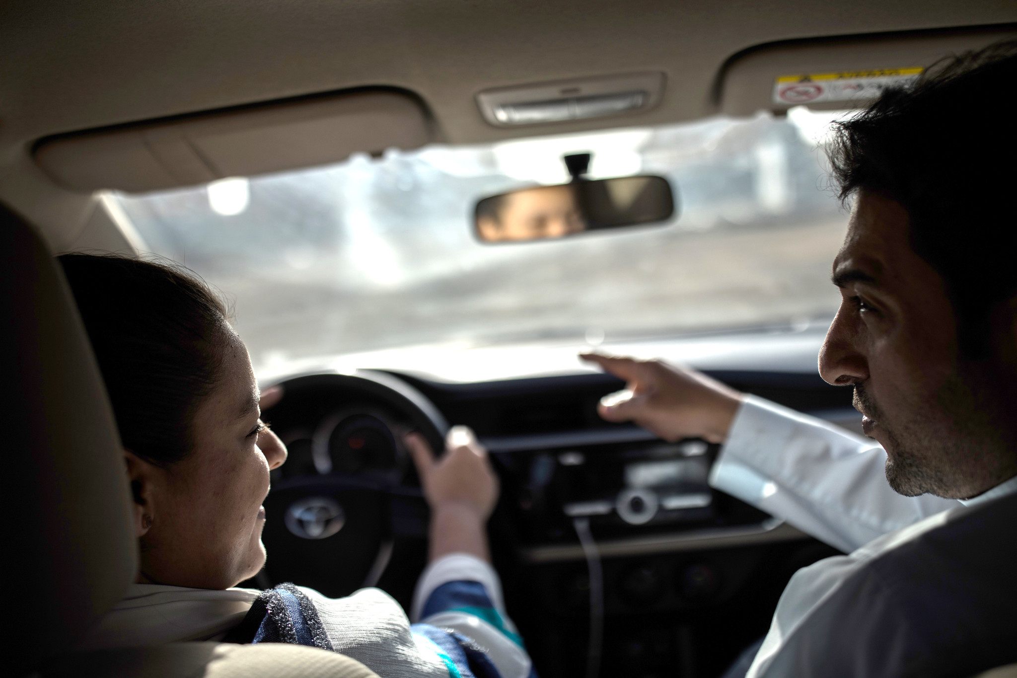 Tala Murad, a Saudi Arabian university, receives driving lessons from her father Midhat in their nei