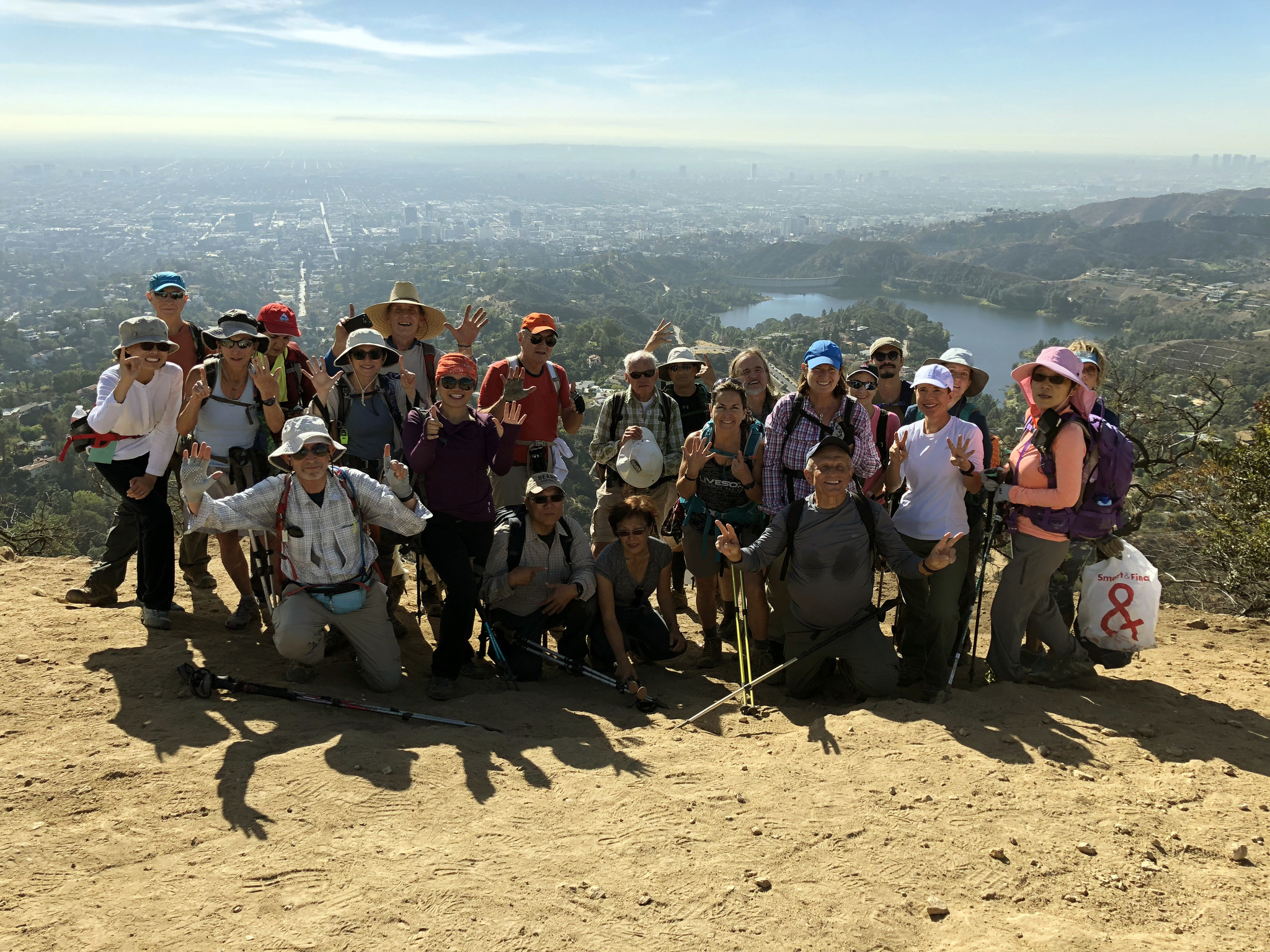 Sierra Club takes hikers to trails near and far. Here a group poses atop Mt. Lee in Griffith Park wh
