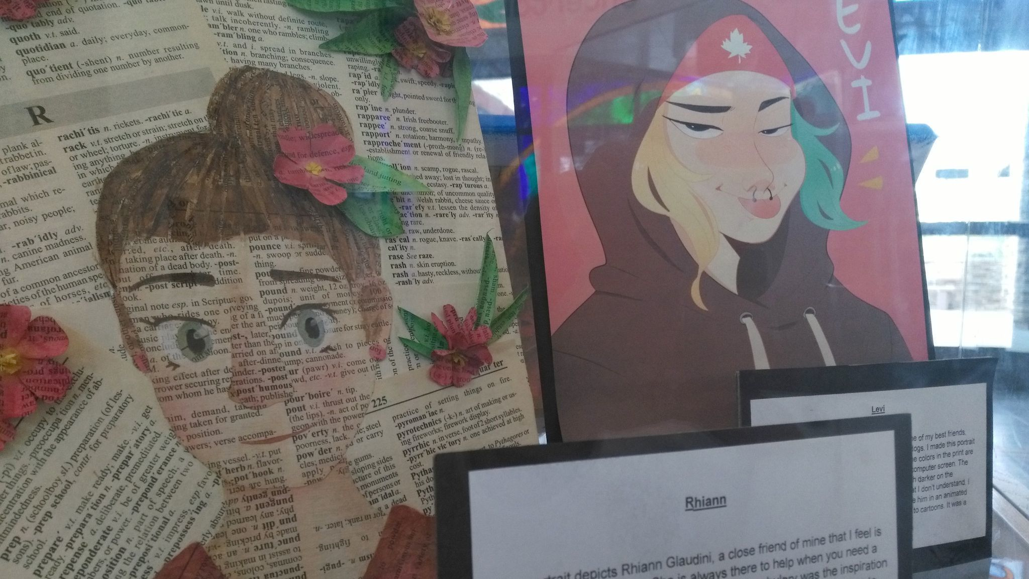 Mountain Valley Academy student Sydney Honadle created a mixed media of Rhiann Glaudini made from torn book pages, left, and Kirsten Nguyen made a print of her friend Levi Papi.