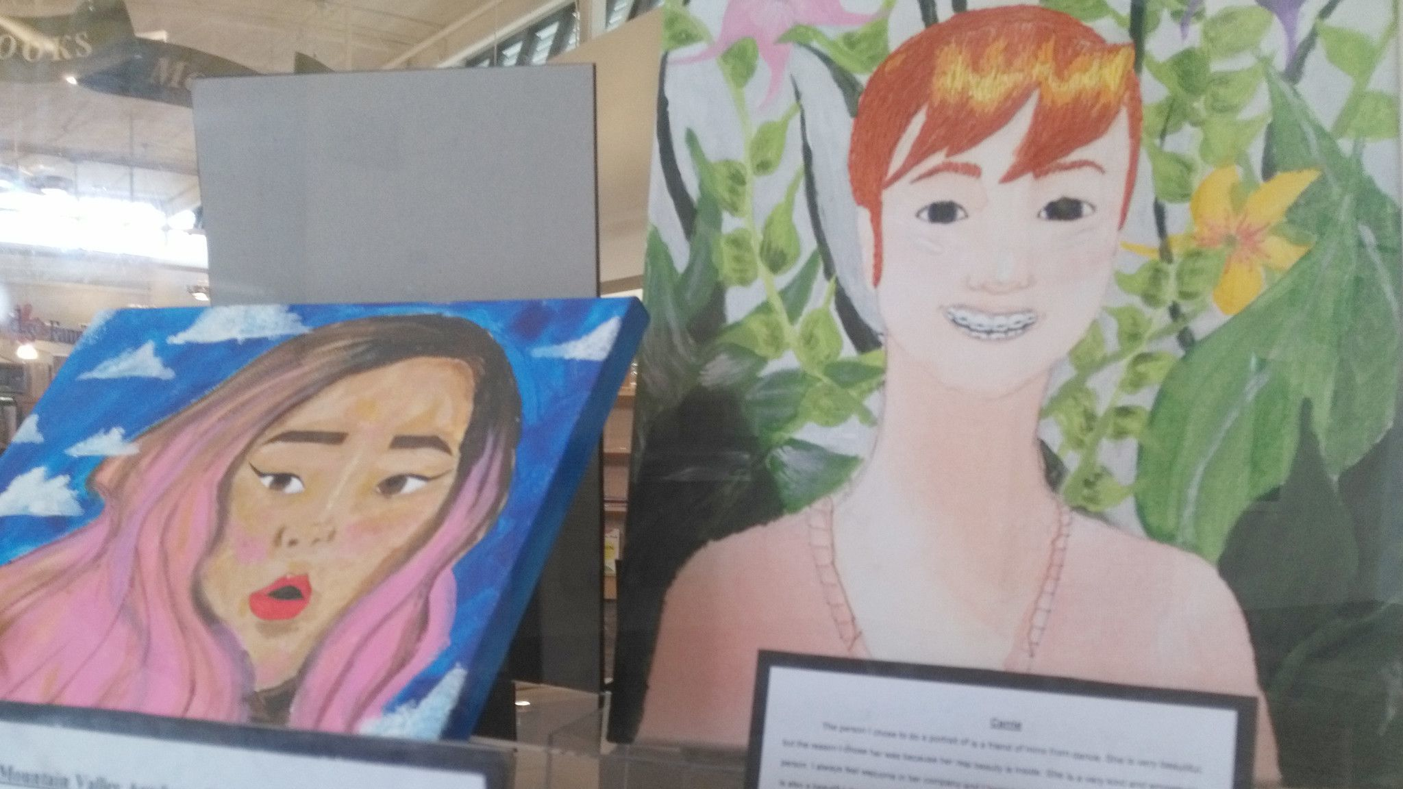 Mountain Valley Academy student Minna Hubler-Hopkins created an acrylic of Kirsten Nguyen, left, and MVA student Helen Buchanan created the mixed-media on the right.