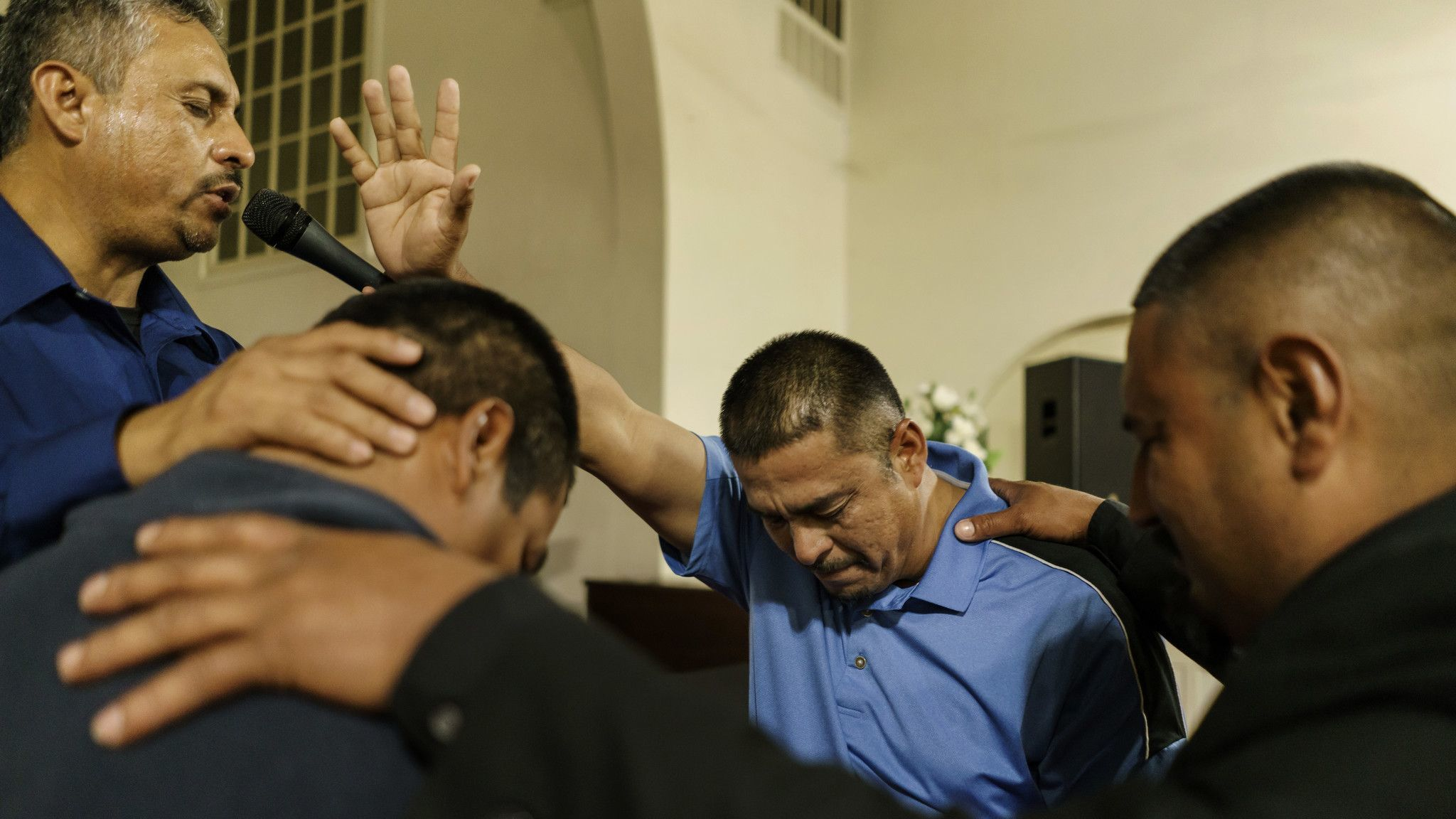WASCO, CALIF. — WEDNESDAY, MARCH 7, 2018: Pastor Guillermo Aceves, far left, and other El Aposento