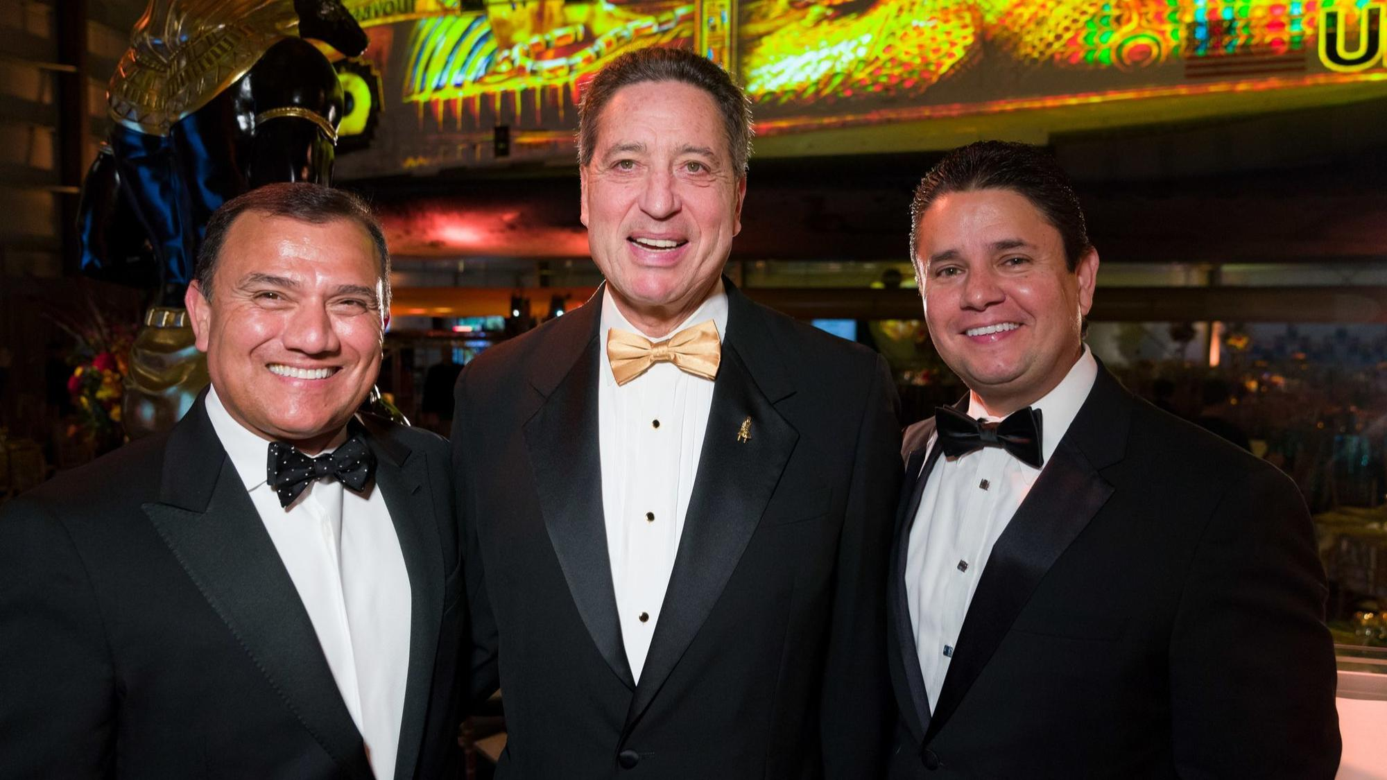 Event co-chairs Raul Anaya and Dennis Arriola with and without Jeffrey Rudolph, president and chief executive officer of the California Science Center.