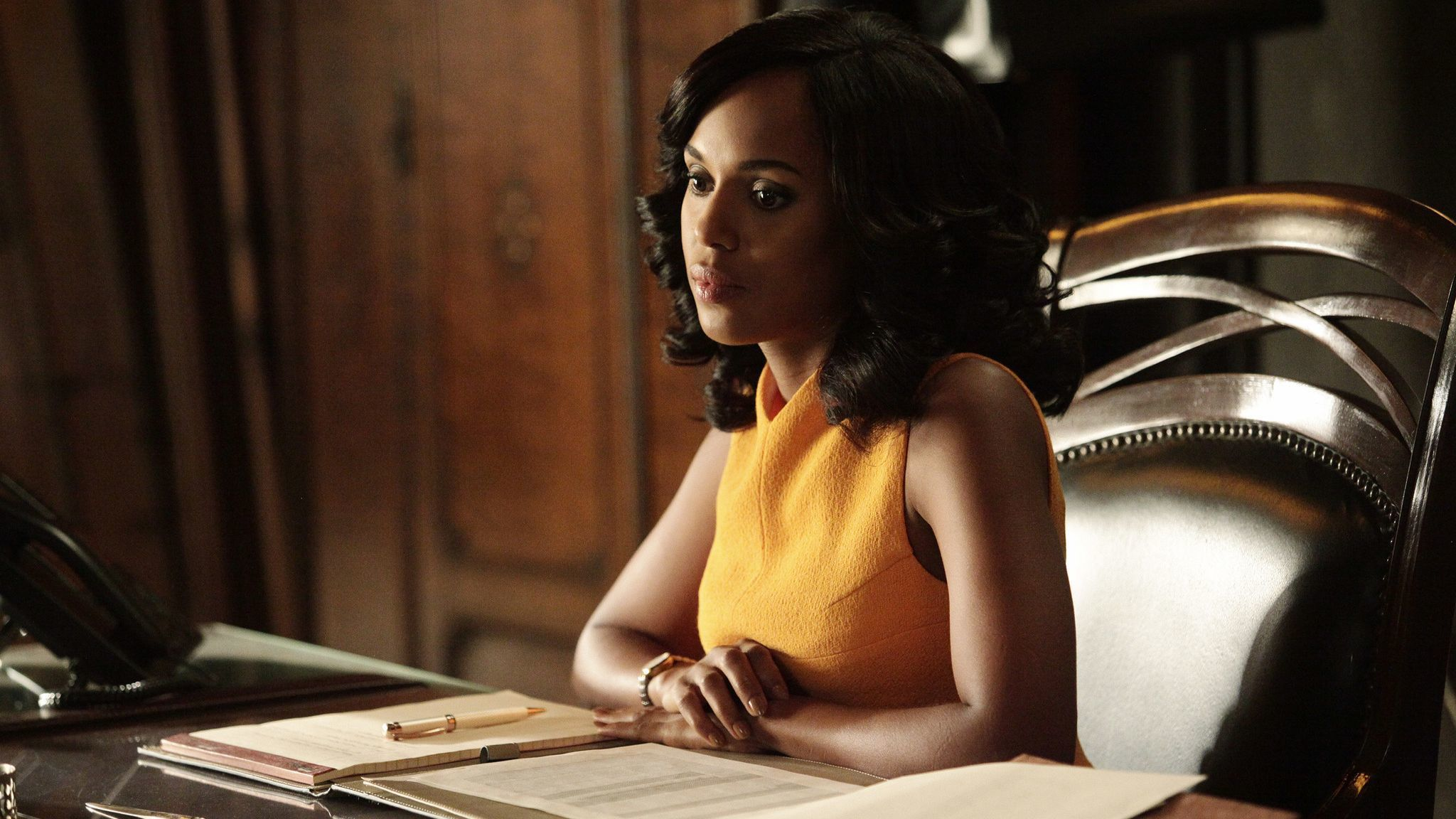 Olivia Pope appears in a bright marigold-colored Narciso Rodriguez dress during the season 5 episode