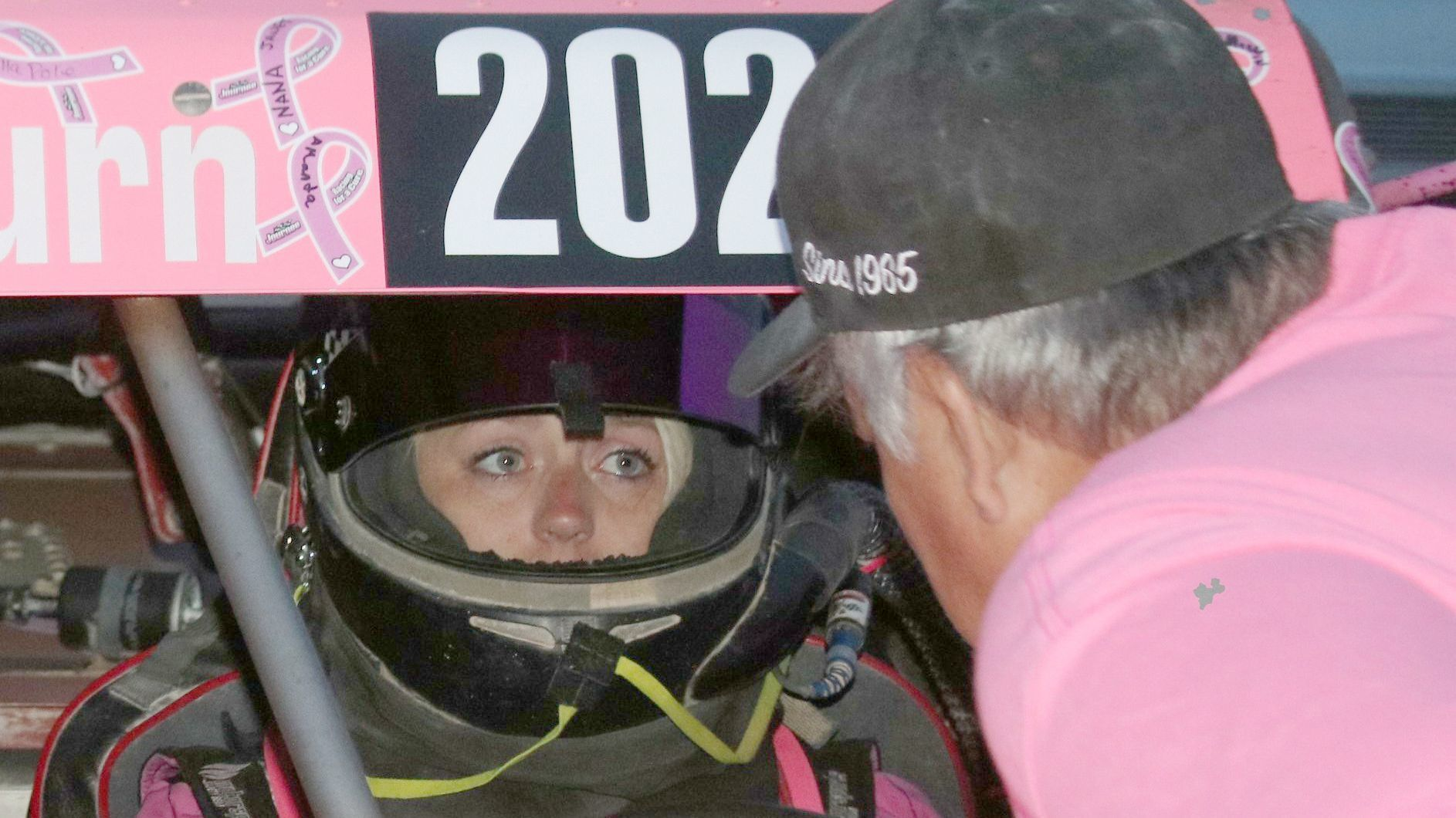 Team DaveCo crew leader David Hendrickson calms Mint 400 Race participant Journee Richardson before the start of the race.