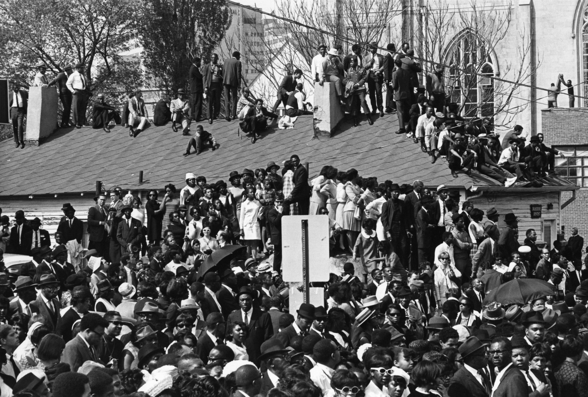 Crowds gather on rooftops near Ebenezer Church in Atlanta during the funeral service of Dr. Martin L