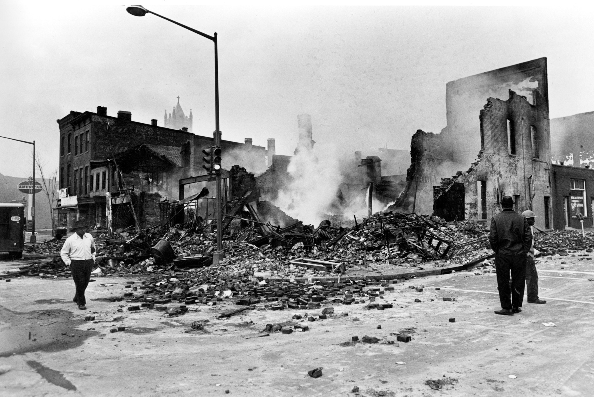 In this April 6, 1968, file photo, smoldering ruins remain where a building stood on 7th and O Stree