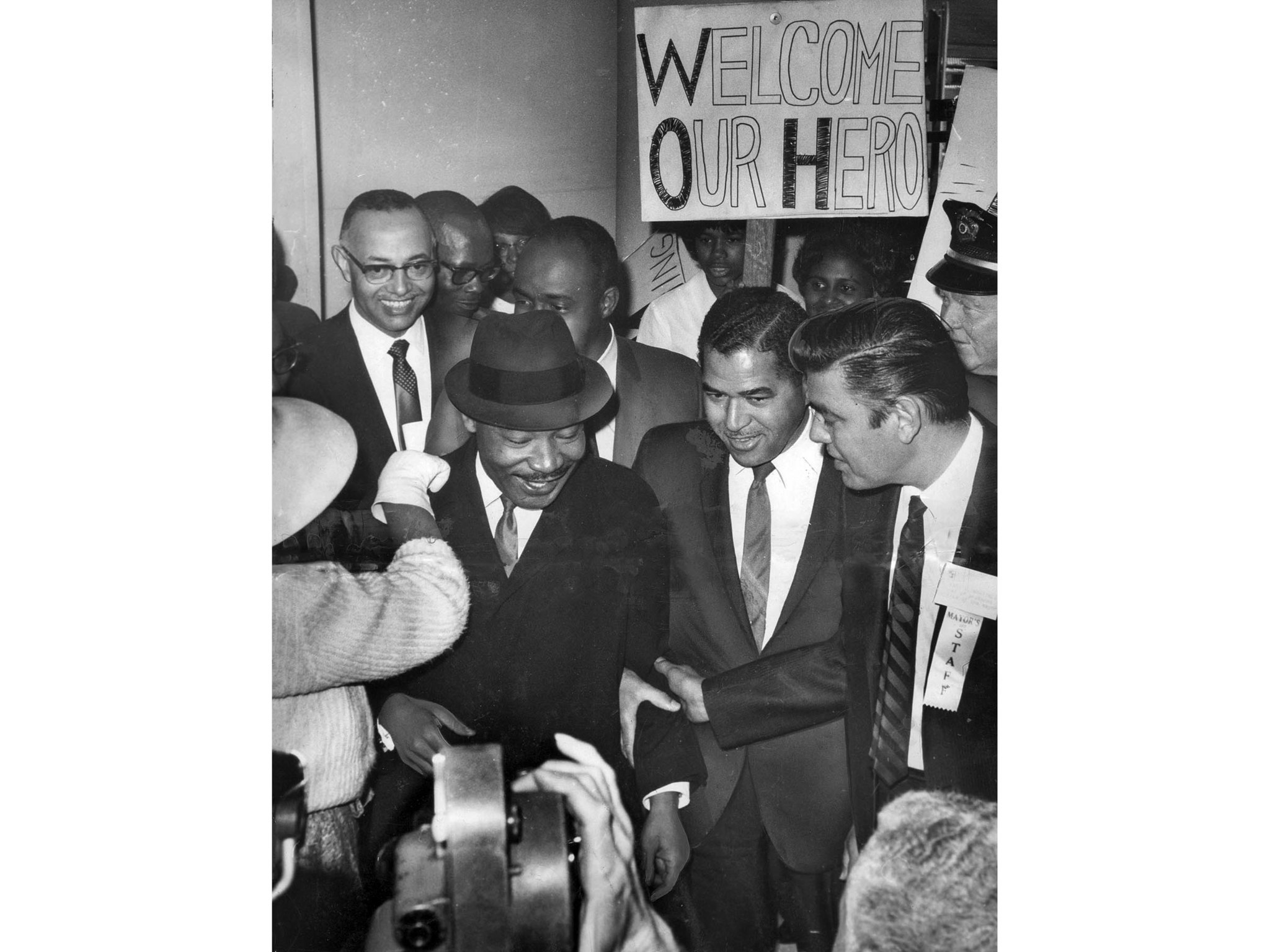 Feb. 24, 1965: Dr. Martin Luther King is welcomed by crowd of admirers on his arrival at LAX. King w