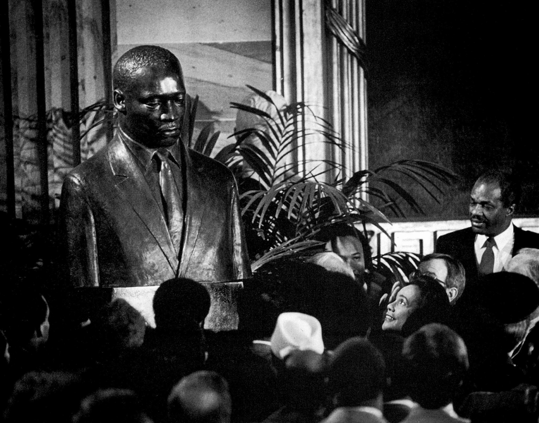 Jan. 16, 1987: Coretta Scott King, lower right, gazes up at a bronze bust of her late husband, Martin