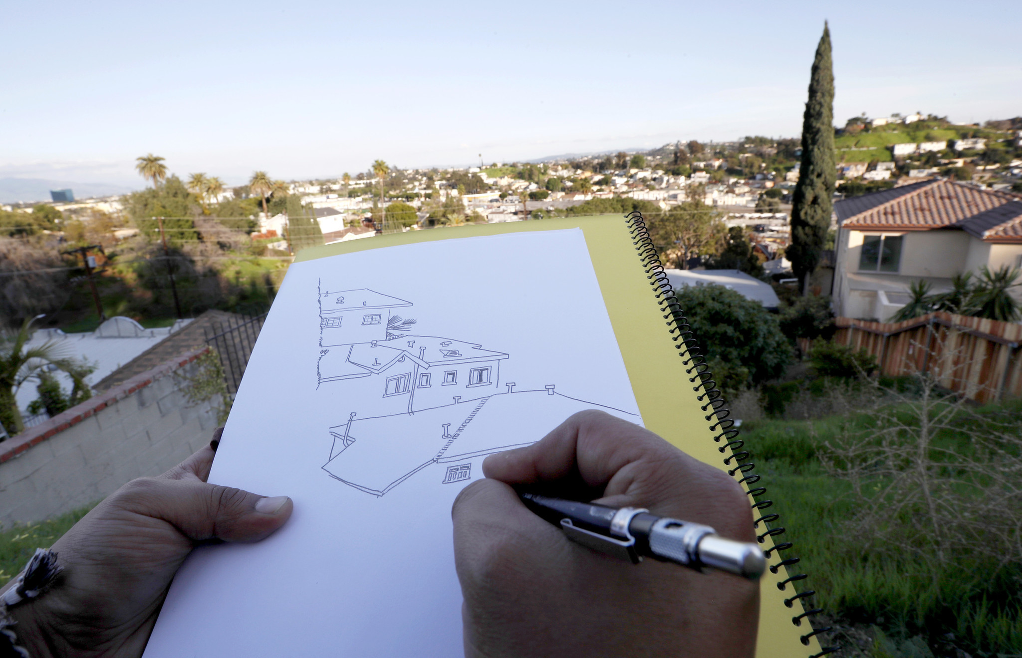 LOS ANGELES, CALIF. - MAR 27, 2018. Manuel Lopez, an artist who makes pencil drawings of hillside c