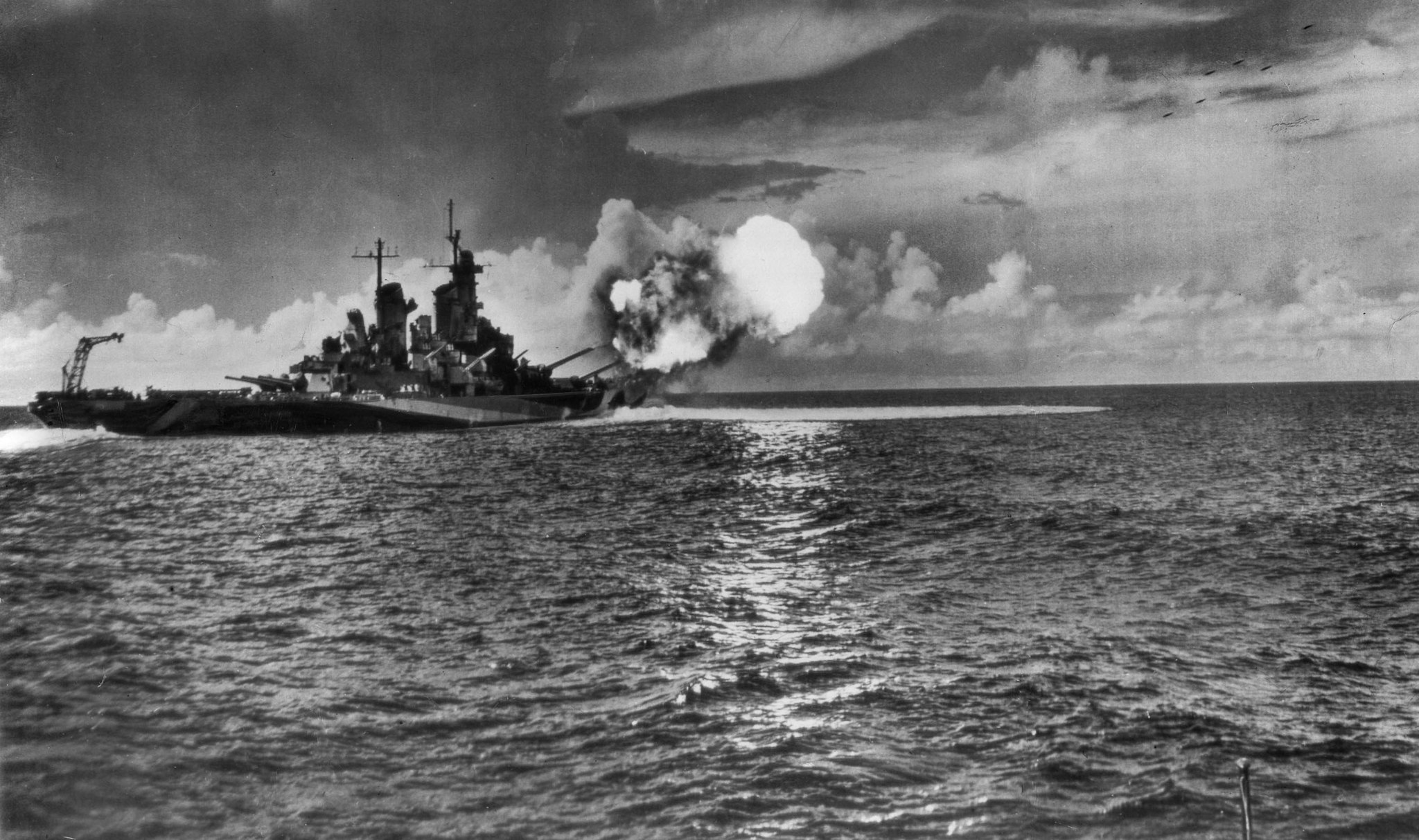 1944: The battlship USS Missouri fires a salvo from the two forward turrets. The 16-inch projectiles