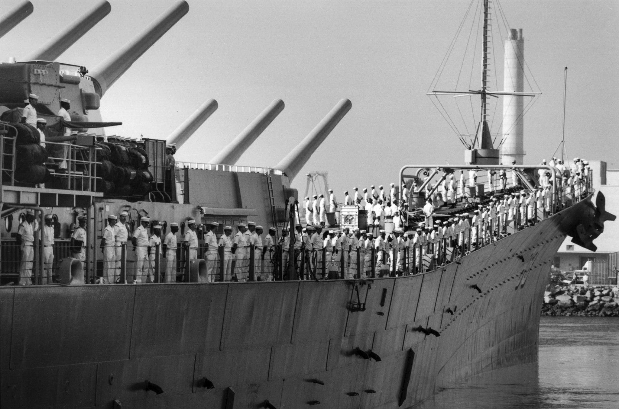 Nov. 13, 1990: The crew of the USS Missouri line the battleship railing as the ship leave the Long B