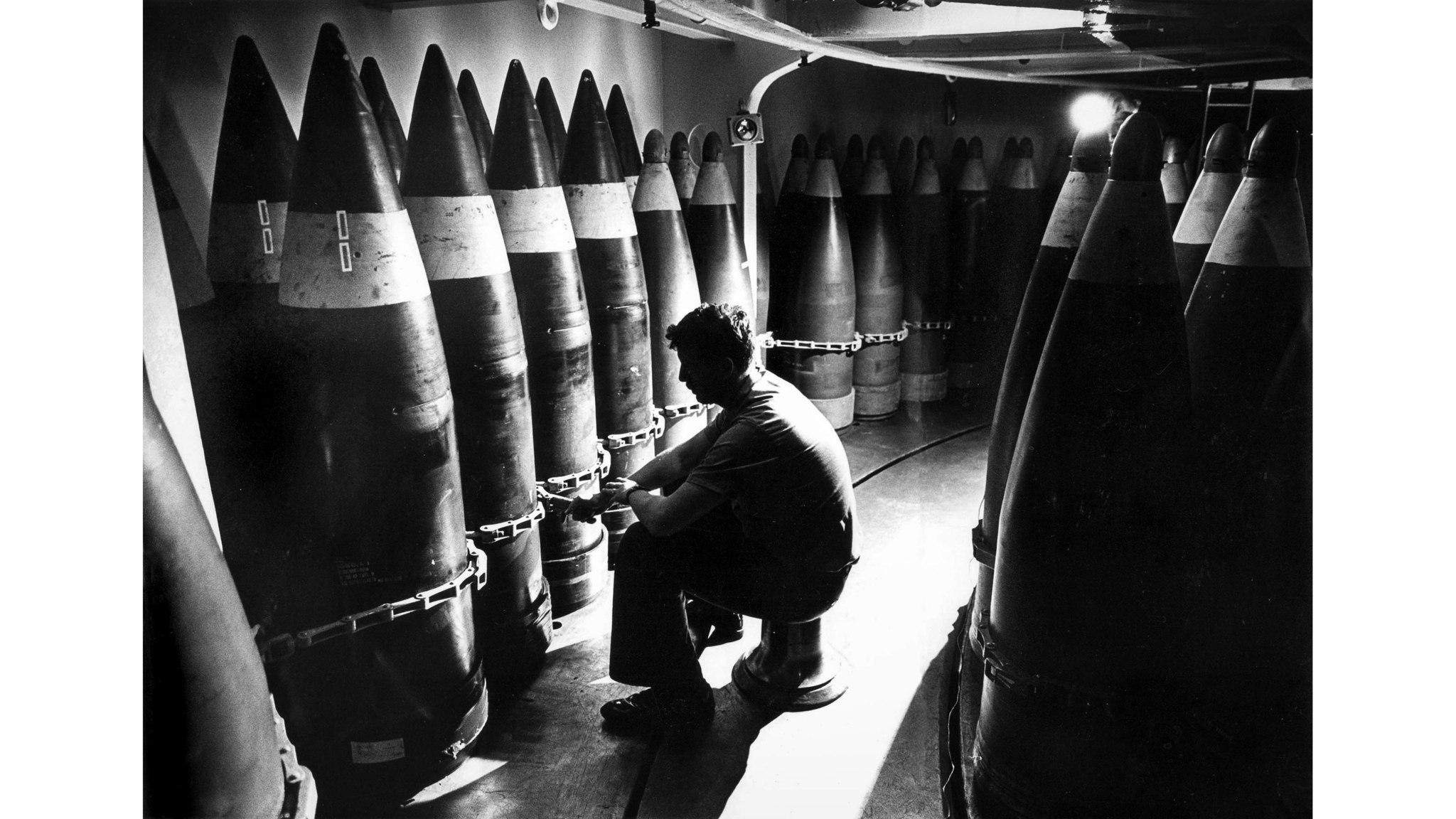 July 2, 1987: Gunners mate Bill Allen does maintenance on 16 inch shells, deep inside the USS Missou