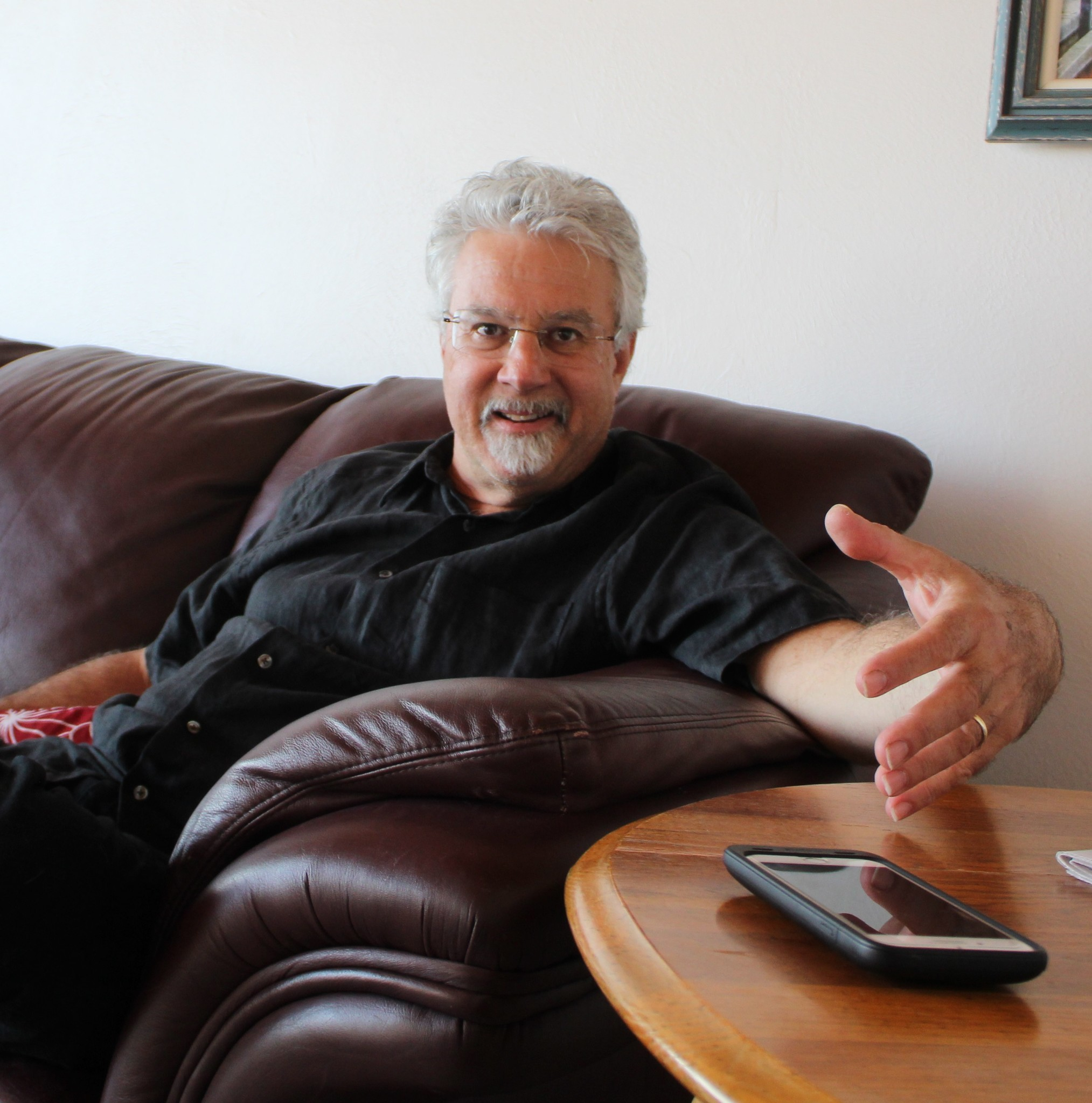 Rock the Choir keyboardist and band leader Andy Shorenstein, a workers' compensation judge by day, relaxes in his Mount Soledad home.