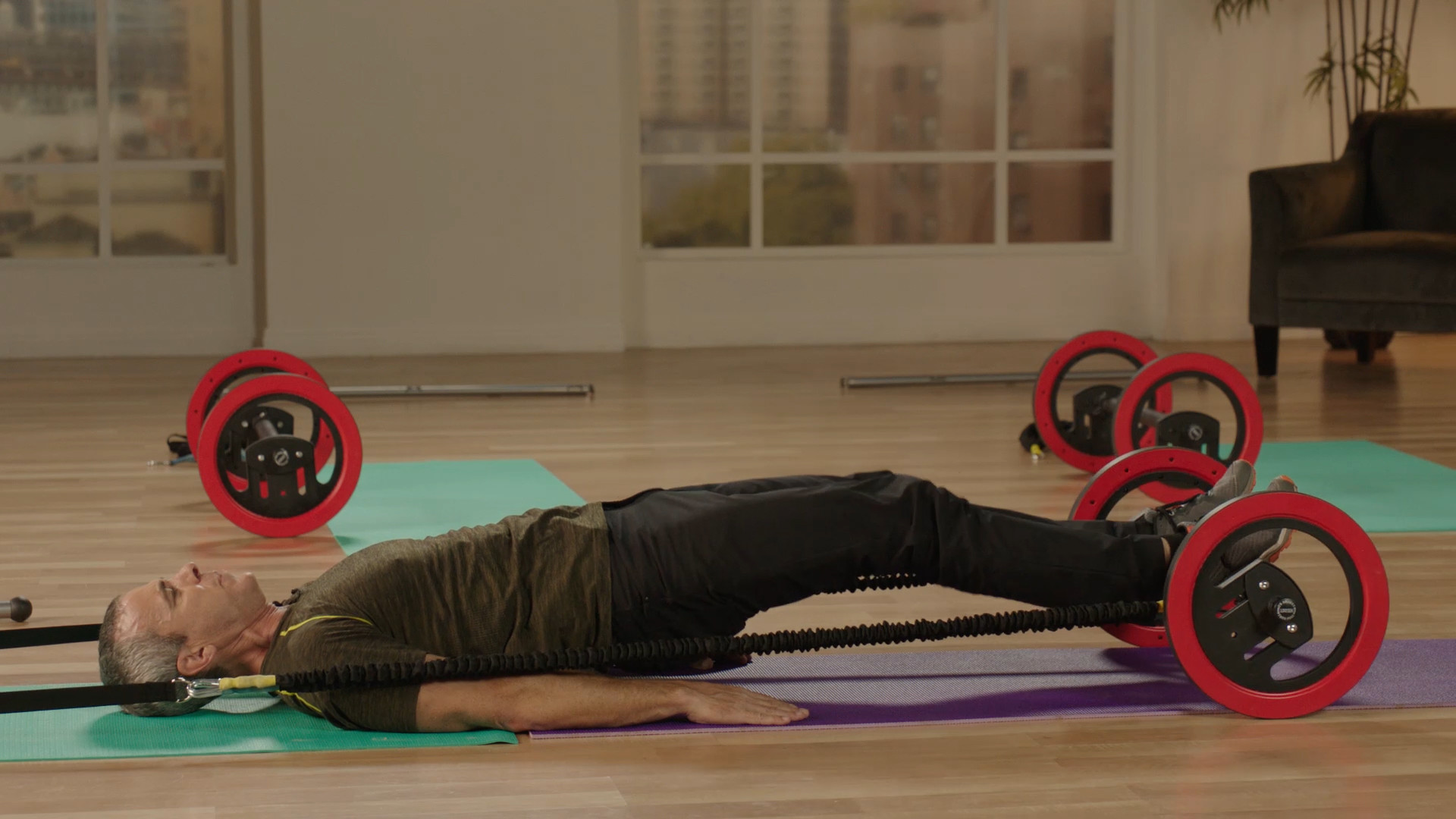 Poor man's Pilates. Assembled in 5 minutes, the Pilates Wheel lets you replicate a range of reformer