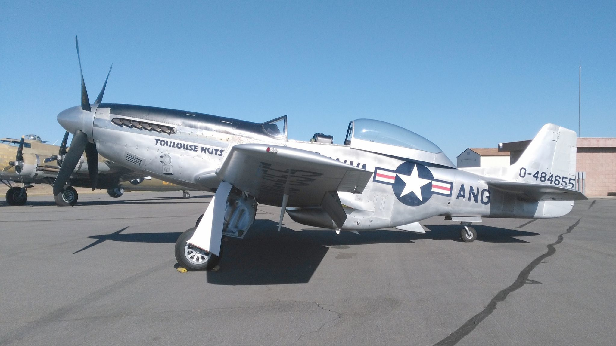 "This P-51 Mustang on display at Ramona Airport for the Wings of Freedom Tour is known as the bombers' ""little friend"" that saved countless crews from attacking Axis fighters."