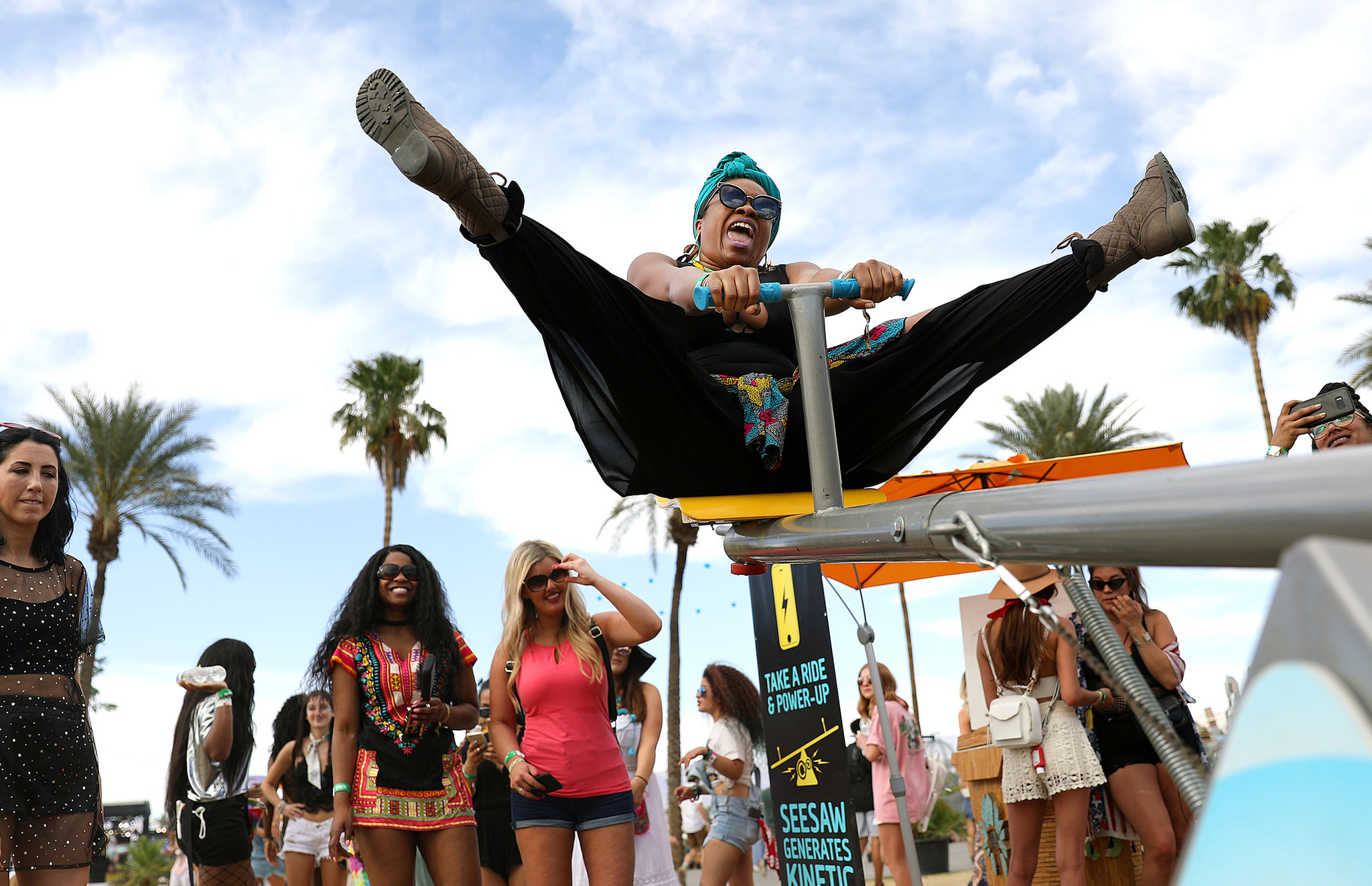 INDIO-CA-APRIL 20, 2018: Jessica Brown, 33, of Oakland, rides a teeter totter at Coachella Weekend 2