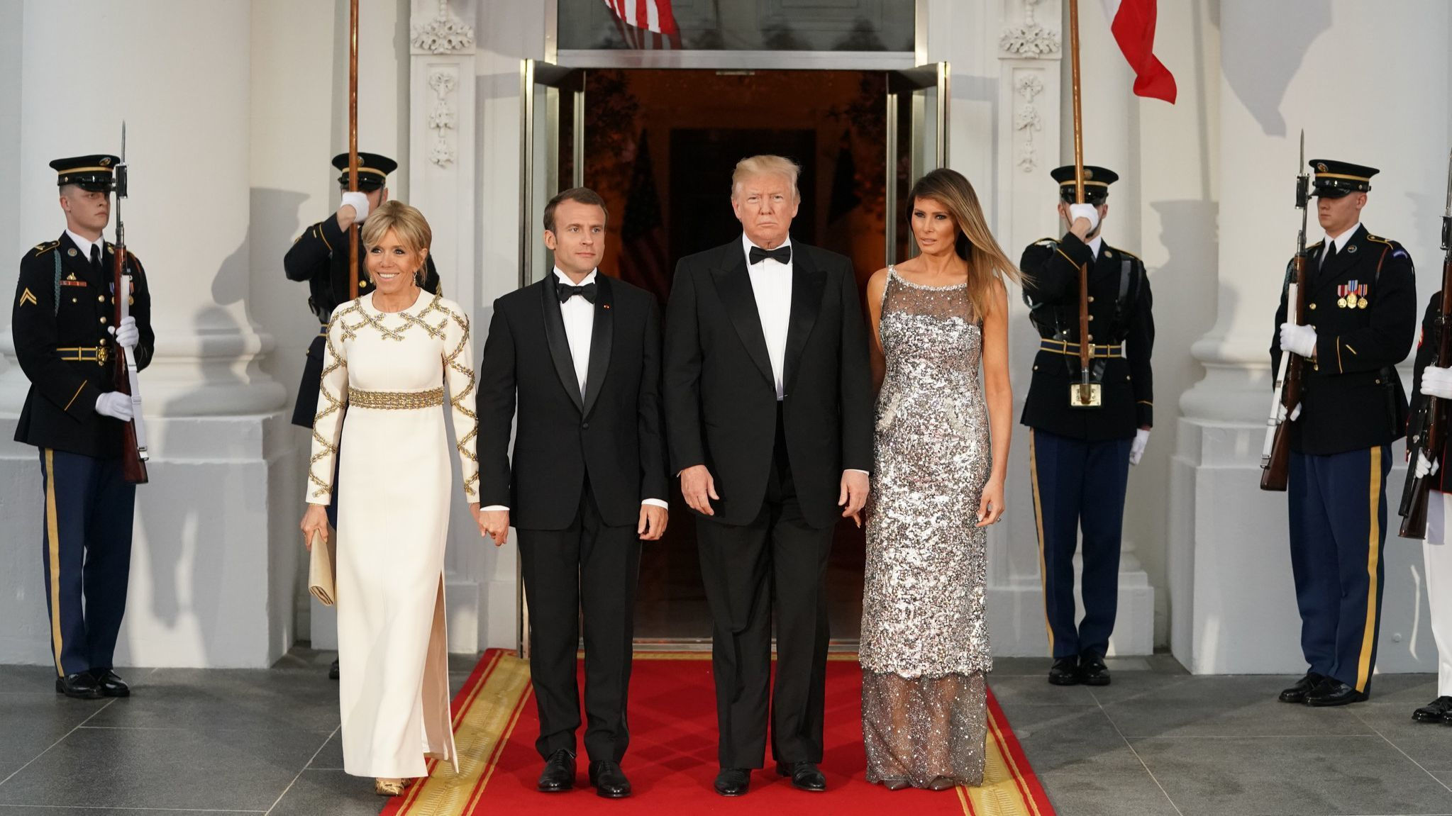 French President Emmanuel Macron's wife Brigitte Macron, left, wears Louis Vuitton, and First Lady Melania Trump wears Chanel for Tuesday's state dinner at the White House.