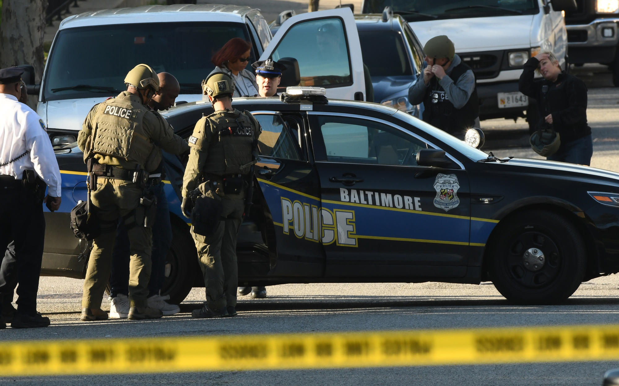Baltimore Police take suspect into custody after hours ...