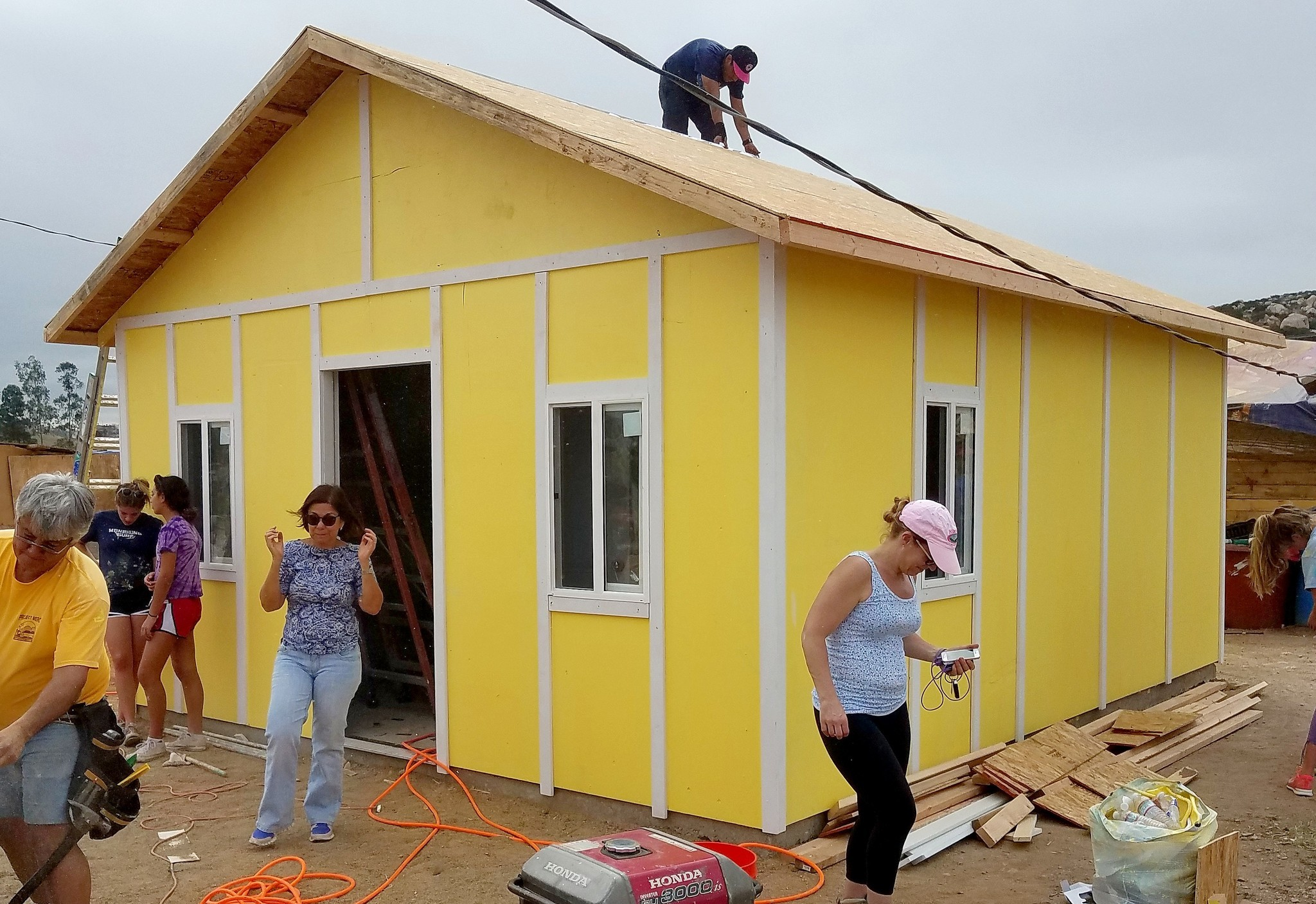 A finished Project Mercy home is always brightly colored, and the hills east of Tijuana are dotted by thousands of them.