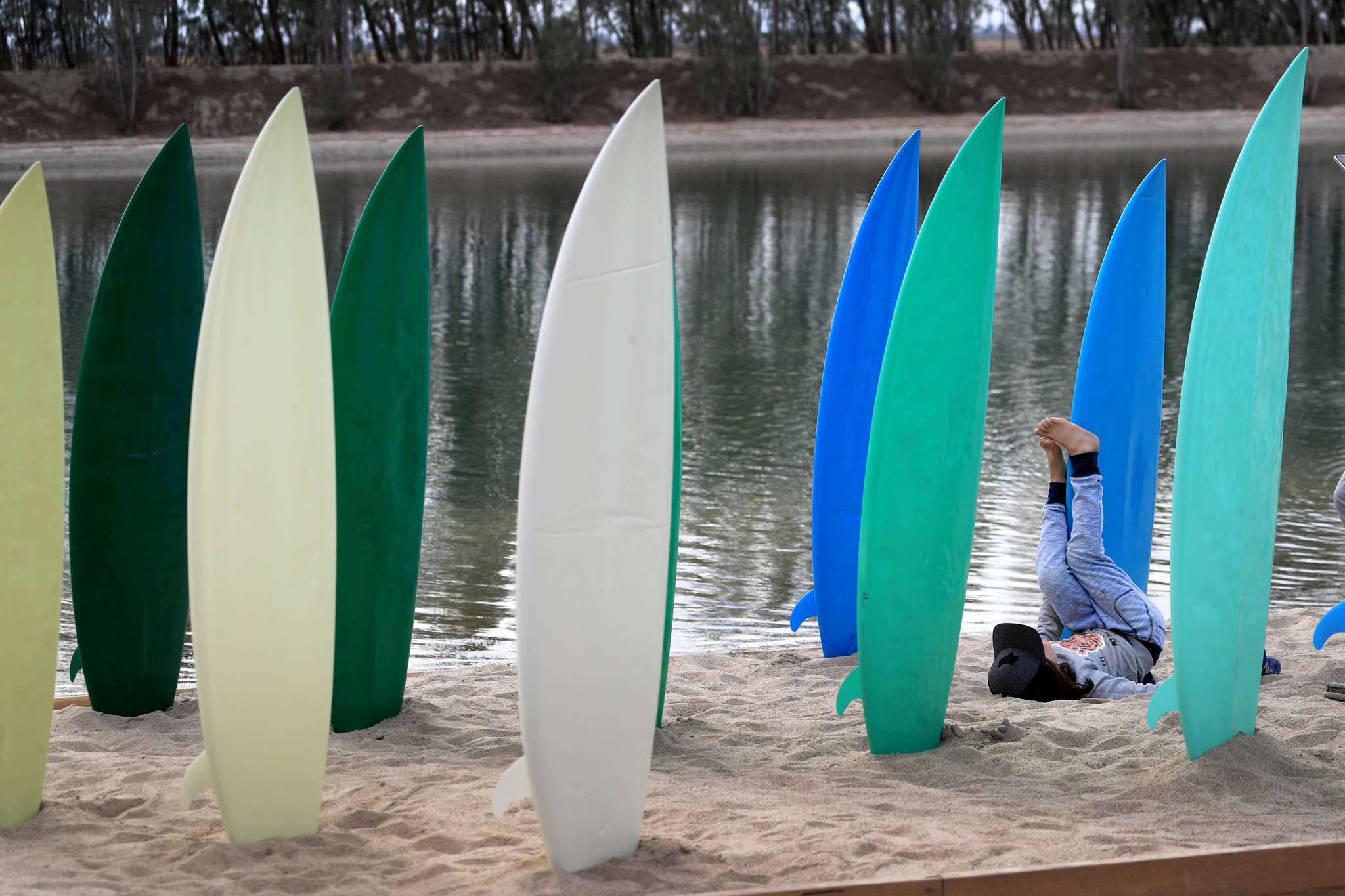 LEMOORE, CALIF. -- SATURDAY, MAY 5, 2018: A child plays in the middle of a surfboard art installatio