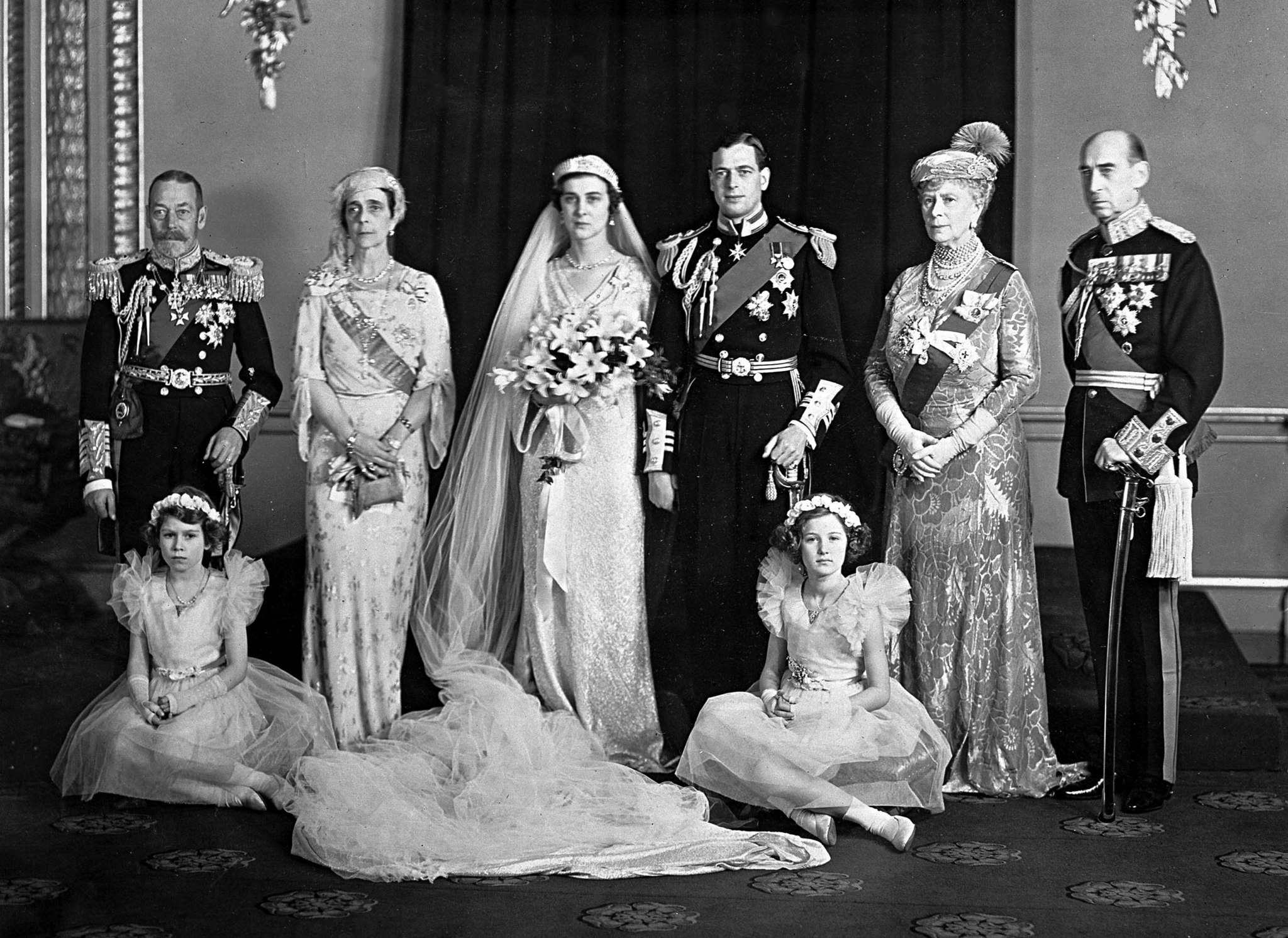 Britian's Princess Elizabeth, later Queen Elizabeth II, sits, left, whilst wedding photographs are t