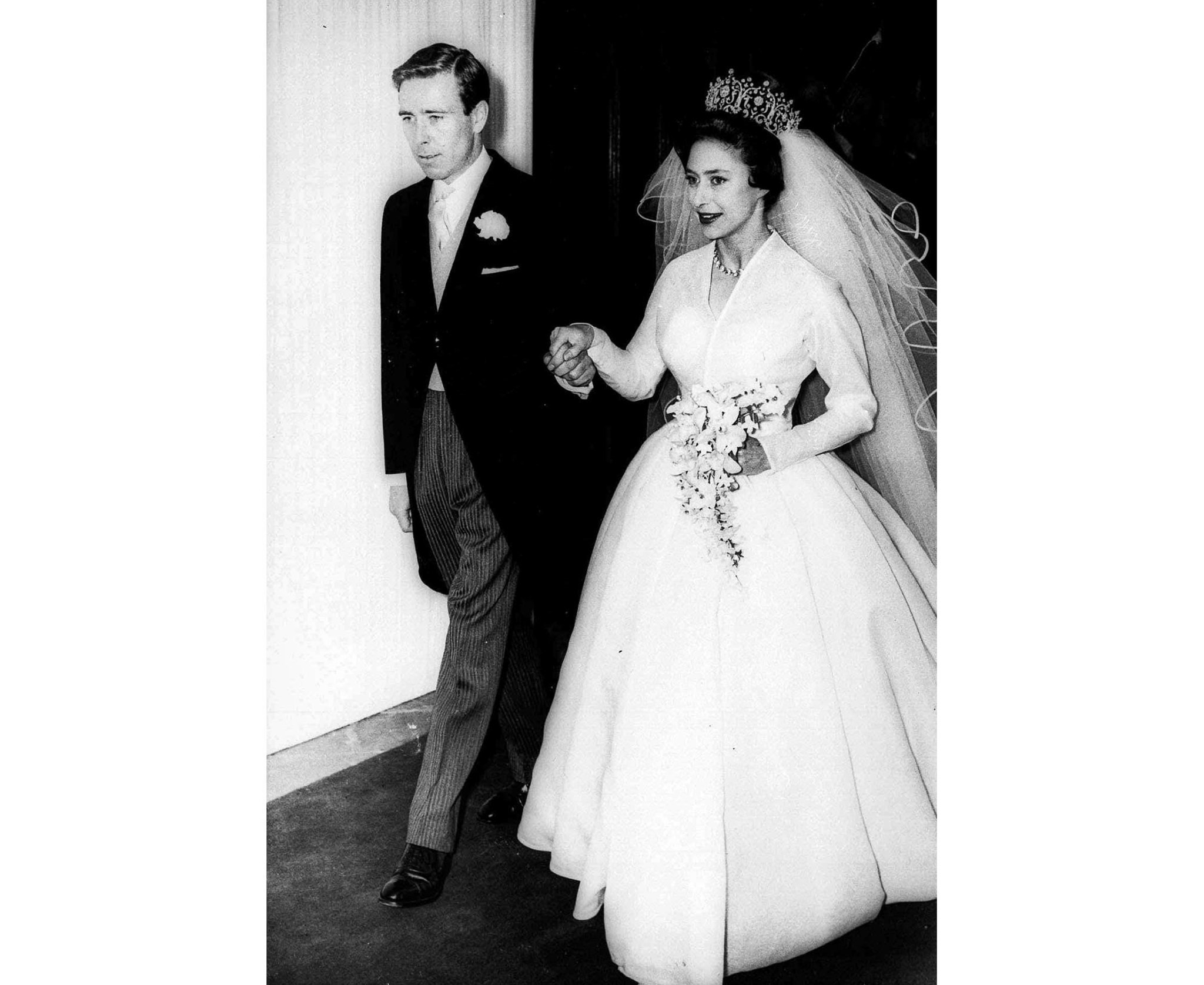 This is a May 6, 1960 file photo of Anthony Armstrong-Jones holds the hand of his bride, Princess M