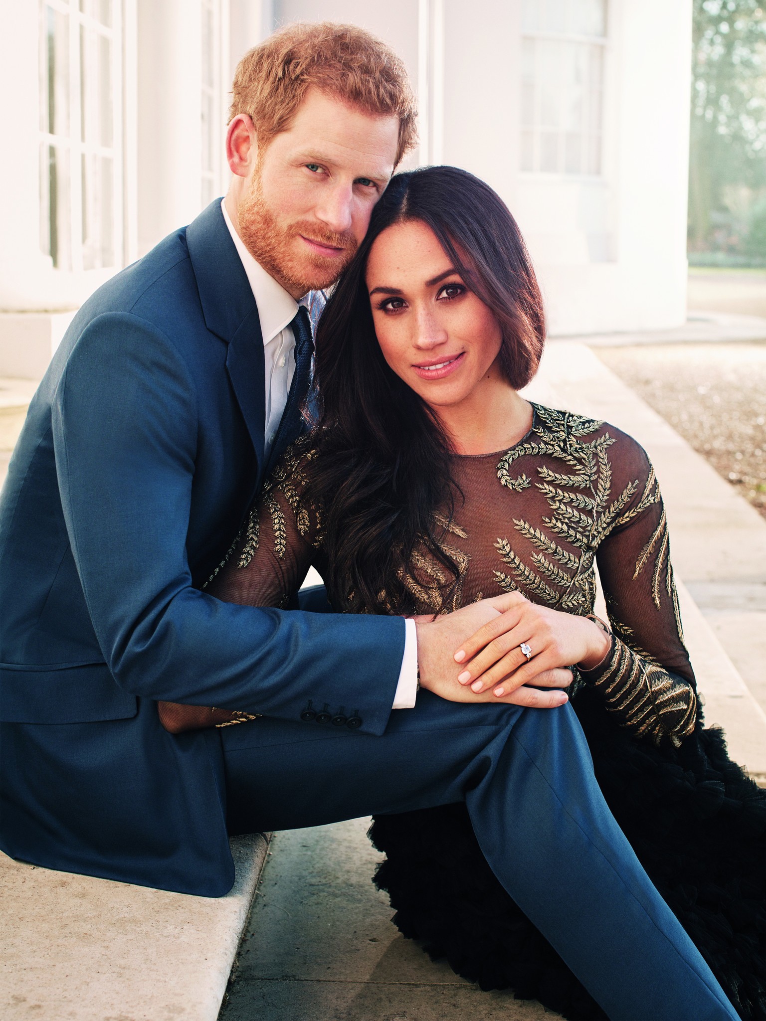 Prince Harry and fiancé Meghan Markle, who's wearing a Ralph & Russo dress, pose for official engagement photos at Frogmore House in December 2017 in Windsor, United Kingdom.