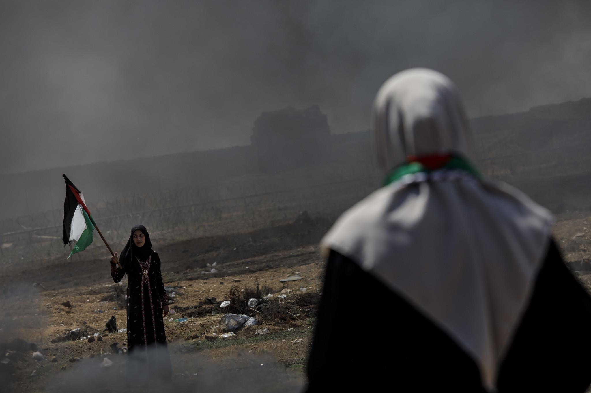 GAZA CITY, GAZA — SUNDAY, MAY 13, 2018: A Palestinian woman wanders the area close to the border fe