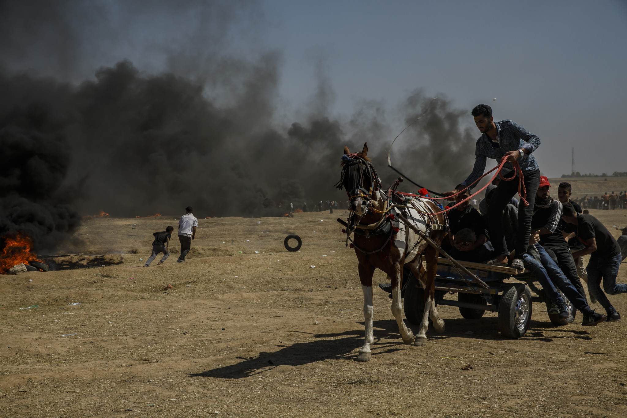 GAZA CITY, GAZA — MONDAY, MAY 14, 2018: Injured protesters are carried away by horse and carriage a