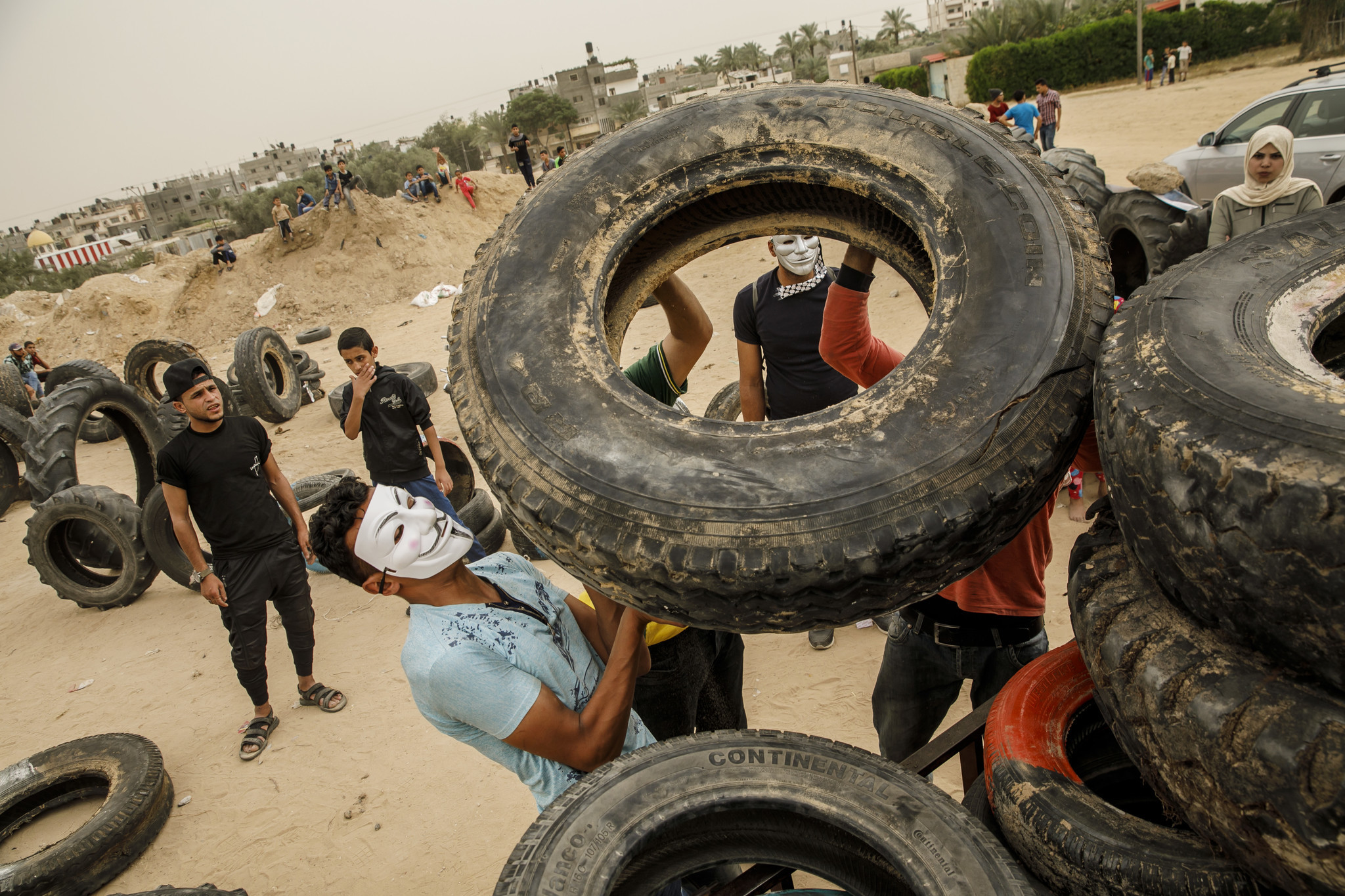 KHAN YOUNIS , GAZA STRIP — THURSDAY, MAY 10, 2018: Palestinian youth organize and transport tires t