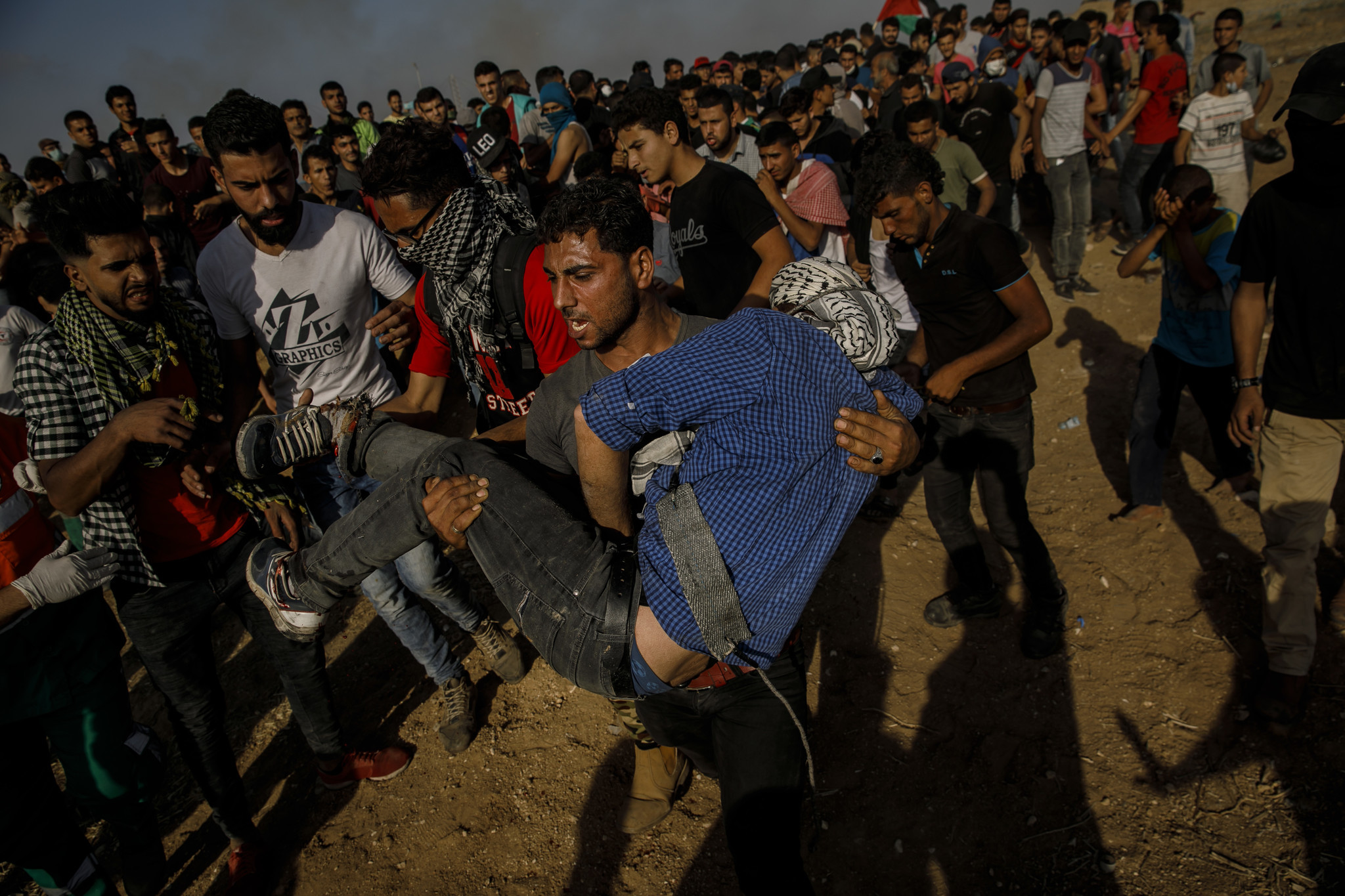 GAZA CITY, GAZA STRIP — FRIDAY, MAY 11, 2018: A Palestinian man carry a fellow protester out after