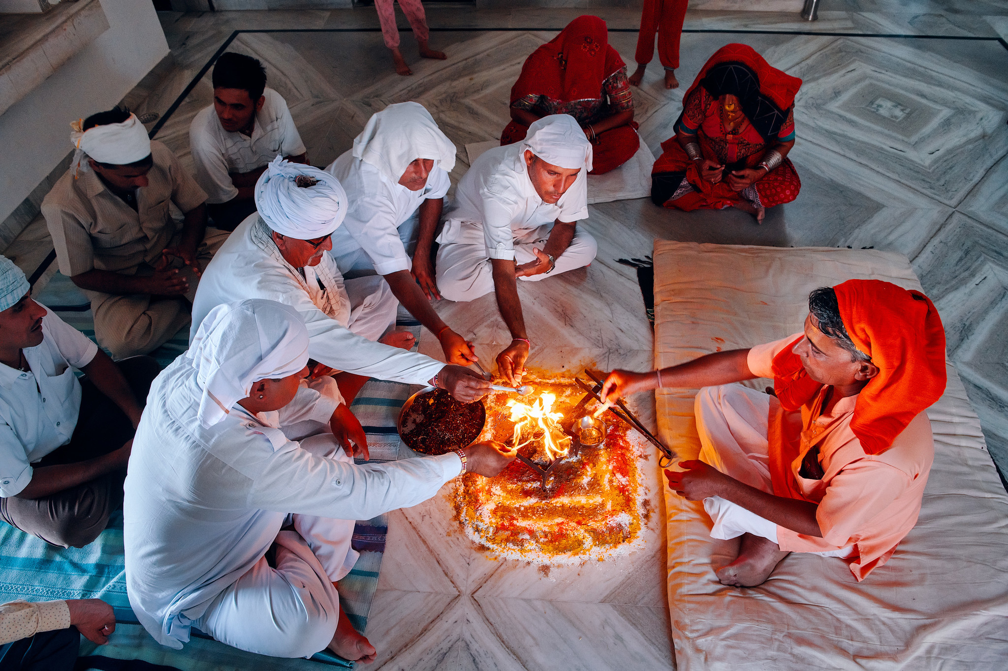 Hanuman Bishnoi and some other men from the village going through the evening prayer at the home of