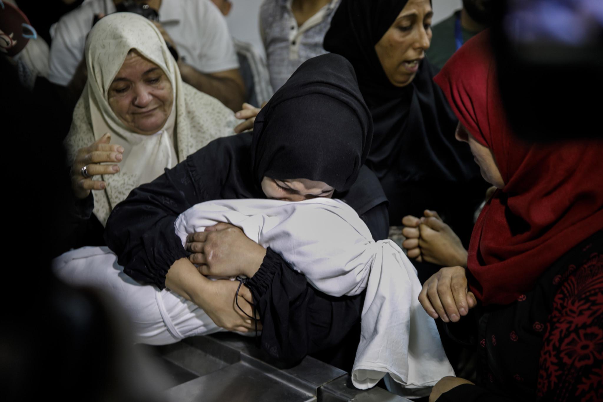 GAZA CITY, GAZA — TUESDAY, MAY 15, 2018: Mariam Mahmud Ahmed Ghandour, mourns her child, Laila Anwa