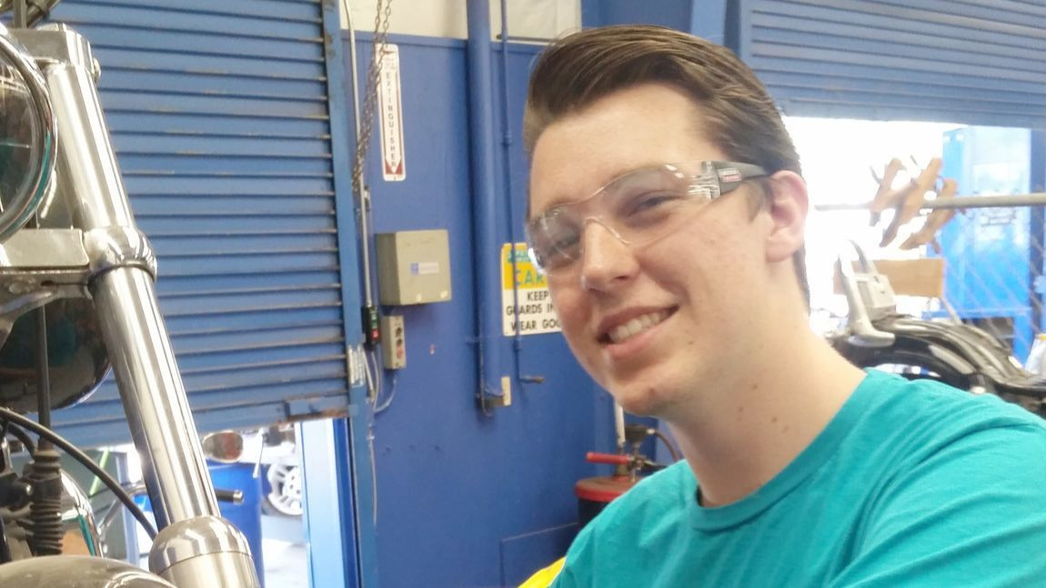 Ramona High School senior Garrett Brown completes a brake service on a motorcycle. He will compete in the Motorcycle Service Technology category of the national SkillsUSA contest.