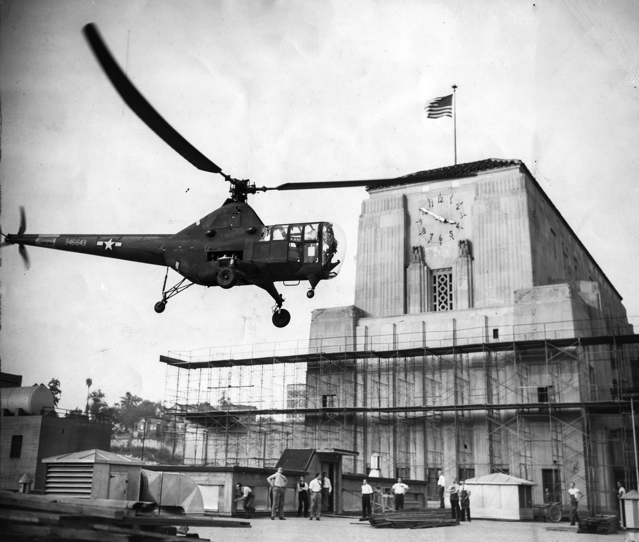 Oct. 26, 1946: Helicopter piloted by U.S Army Airforce pilot Lt. Edward H. Frost drops Coliseum foot