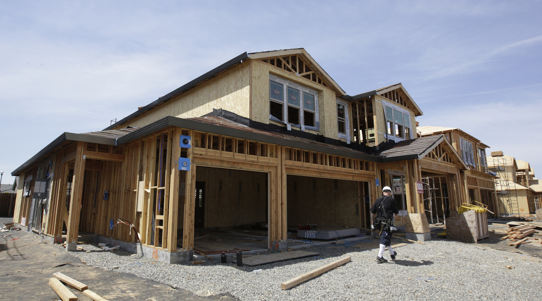 FILE- This May 4, 2018, file photo shows a house under construction in Roseville, Calif. The six maj