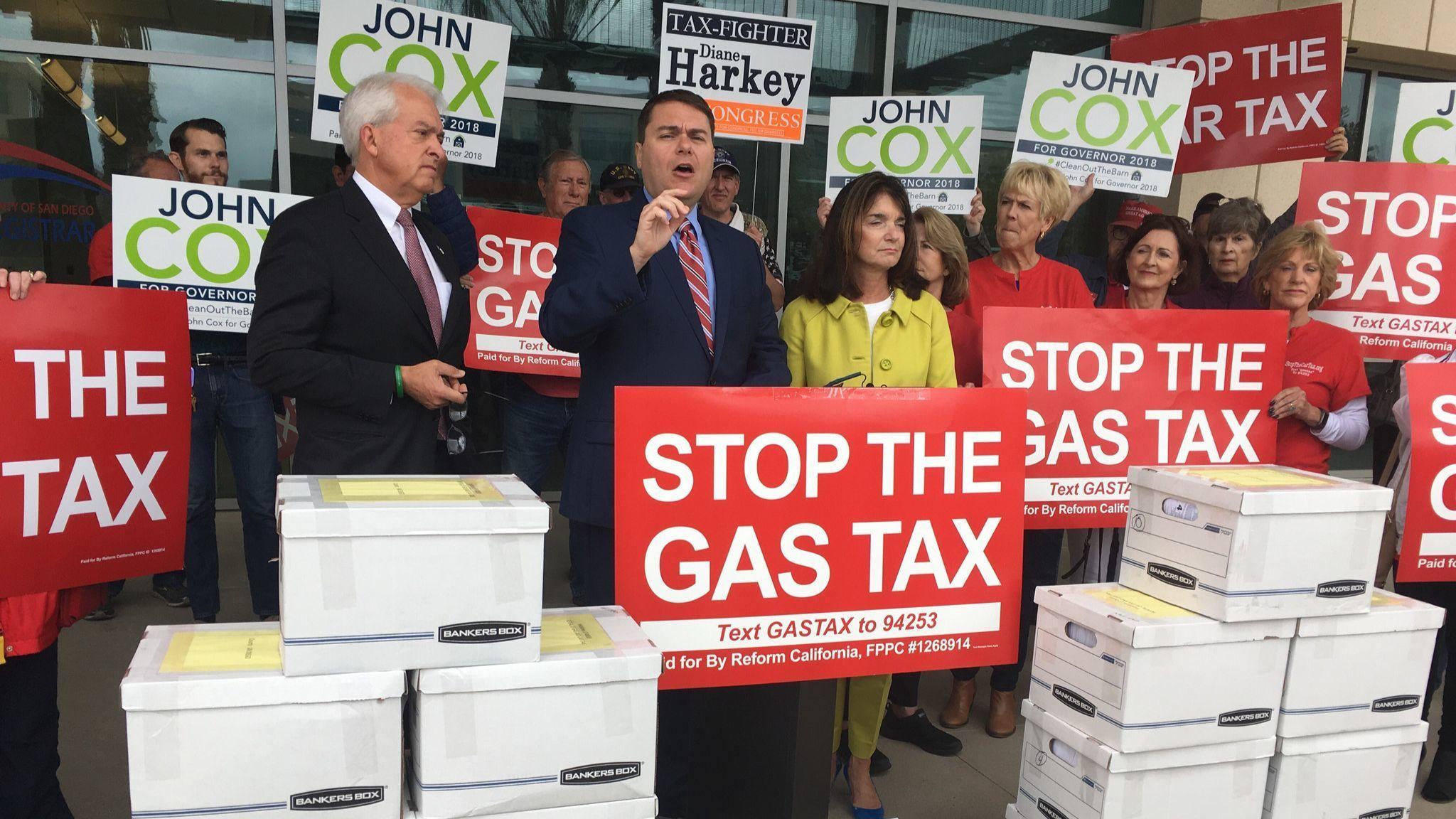 Republican gubernatorial candidate John Cox, left, and organizer Carl DeMaio, center, who led a peti