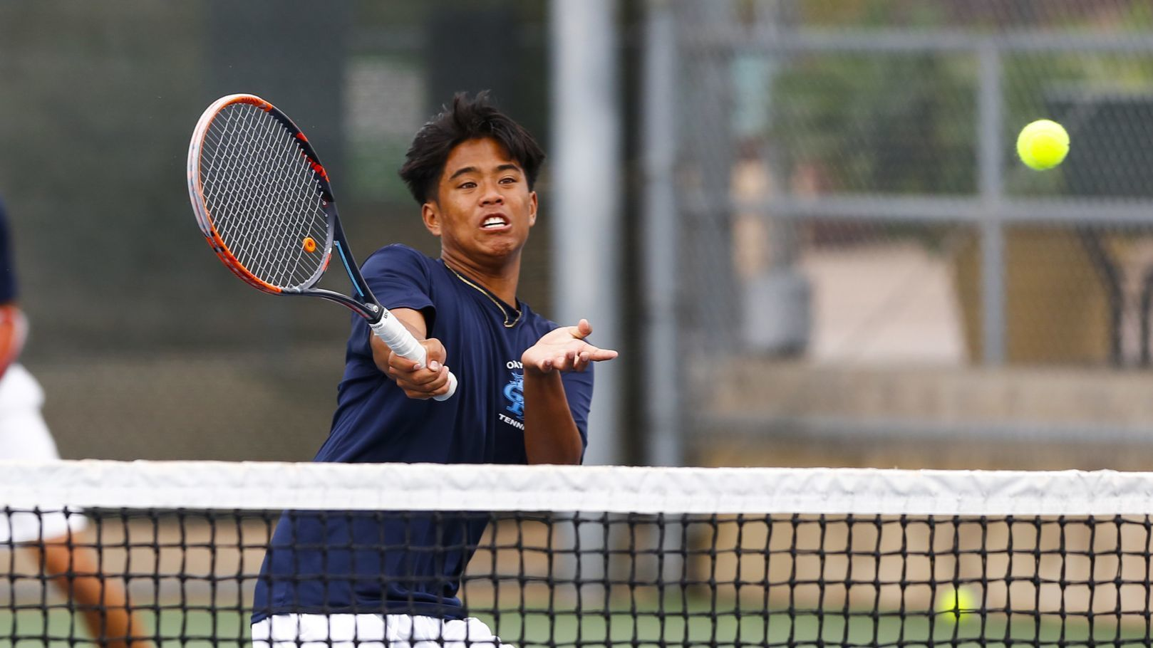 Otay Ranch's Daniel Dulay hits a volley at net as Matthew Lanahan stays back during their first set against Rancho Bernardo.
