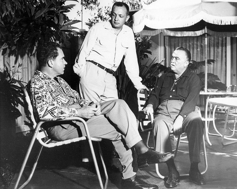 Vice President Richard Nixon, from left, U.S. Congressman Bob Wilson and J. Edgar Hoover chat poolside at the Hotel Del Charro in 1956.
