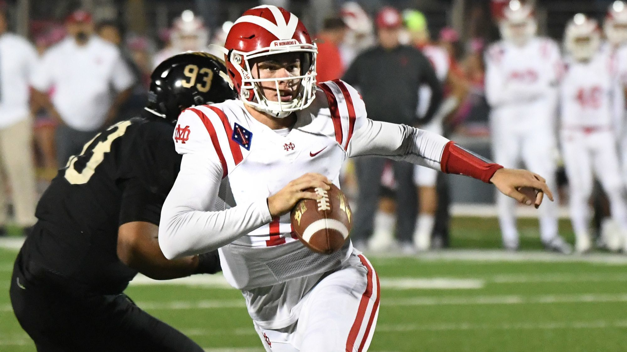 Mater Dei quarterback JT Daniels avoids the St. John Bosco def