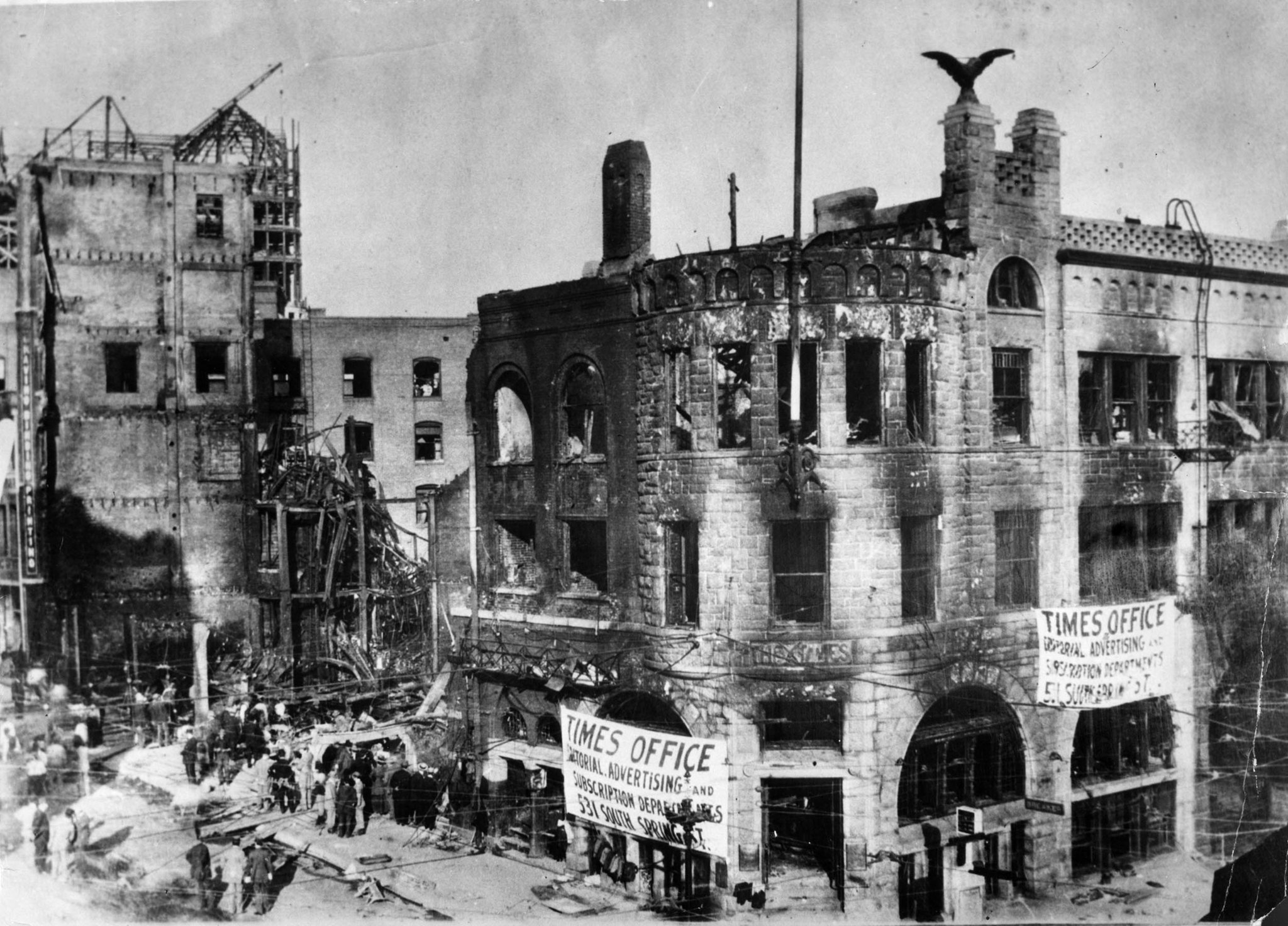 Oct. 1910: The bombed out Los Angeles Times building with poster announcing temporary locations of T